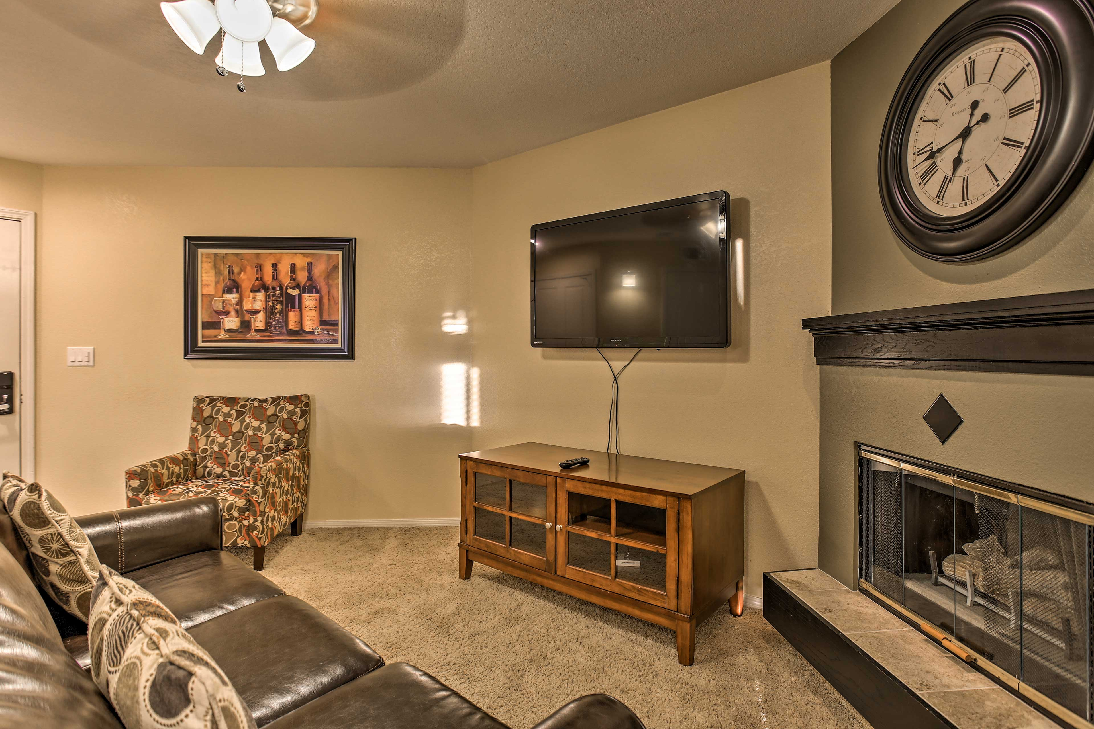 After a busy day, unwind in front of the electric fireplace in the living area.