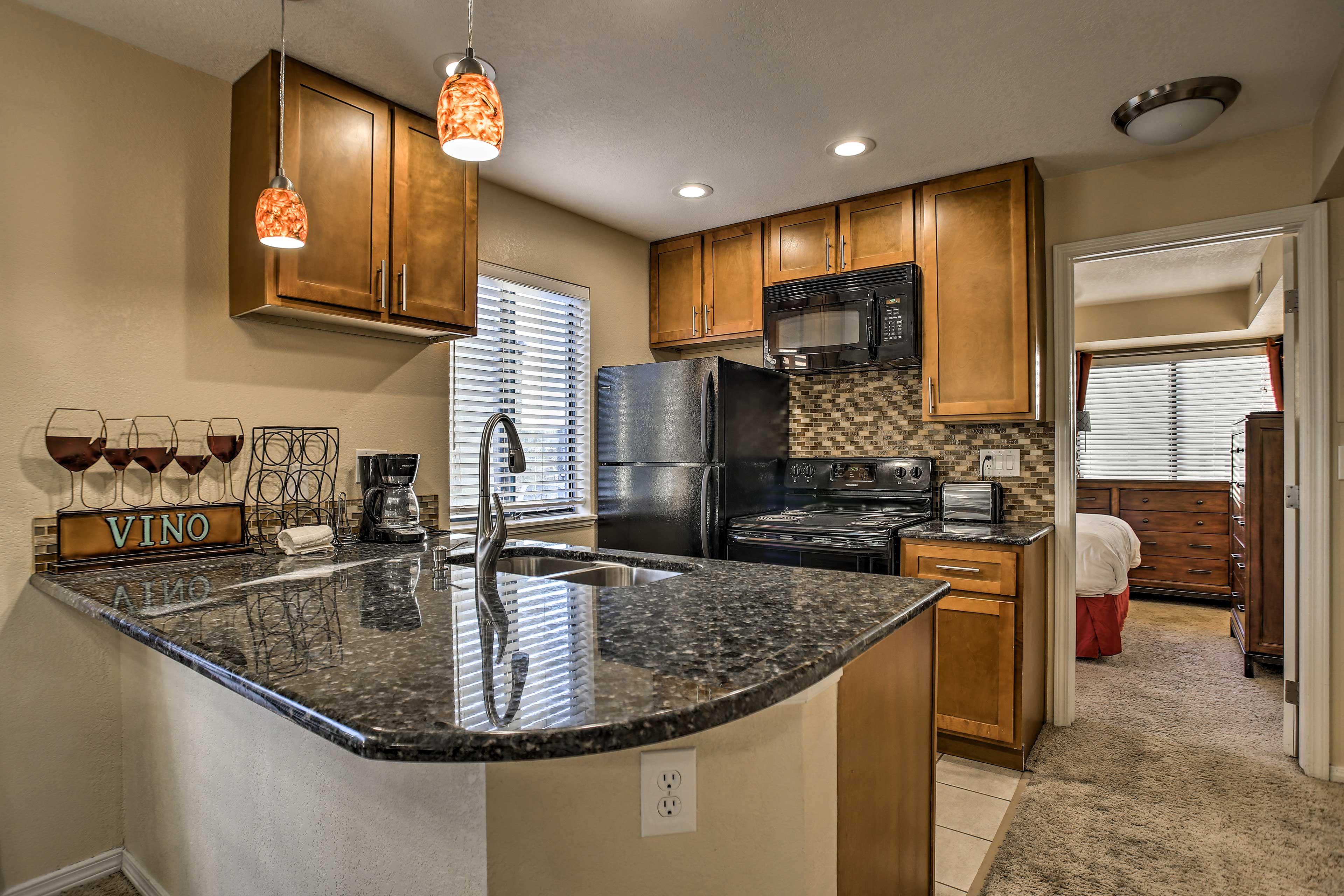 The kitchen boasts beautiful granite counters.