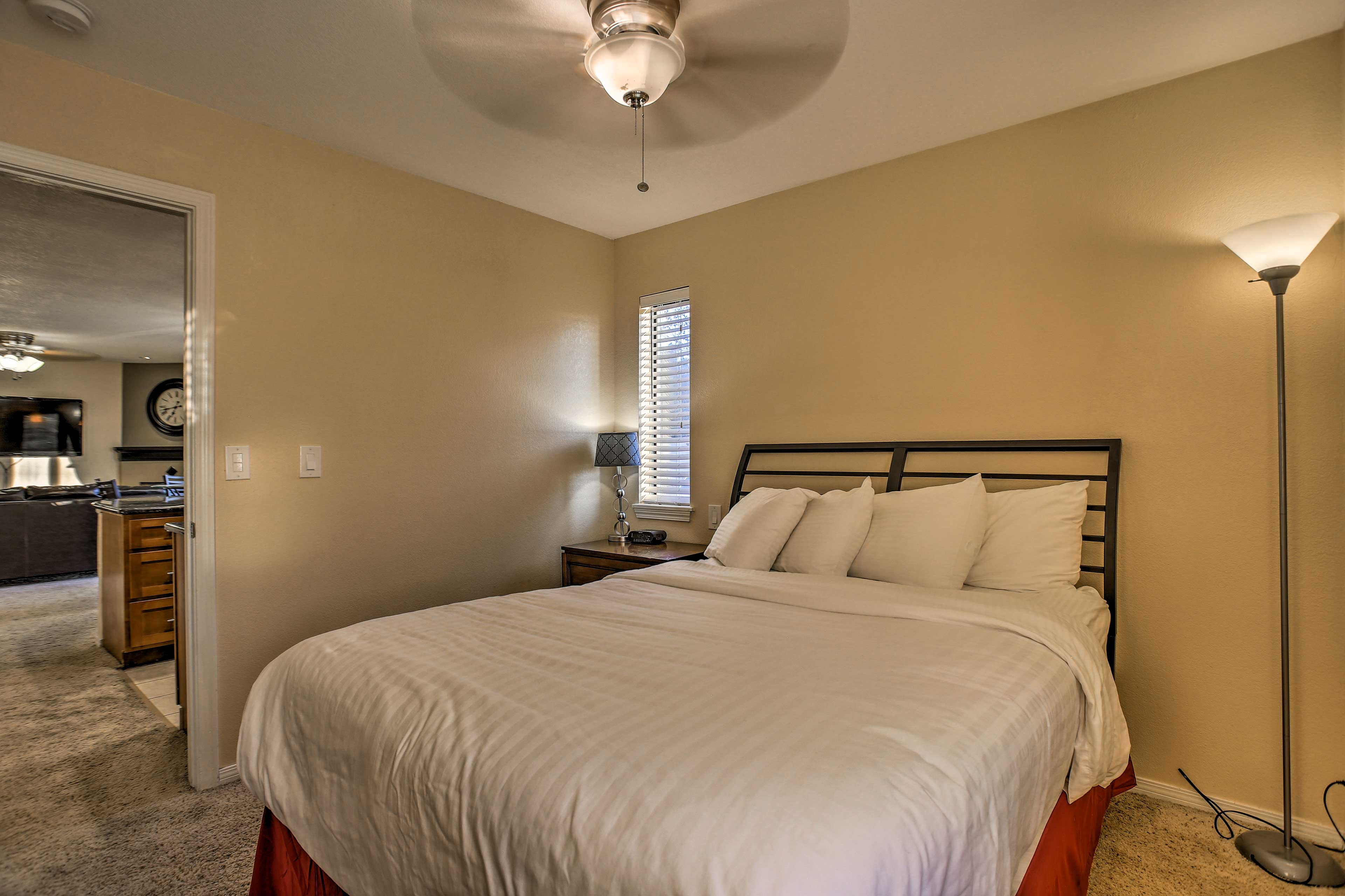 Rest easy on the queen bed in this room.