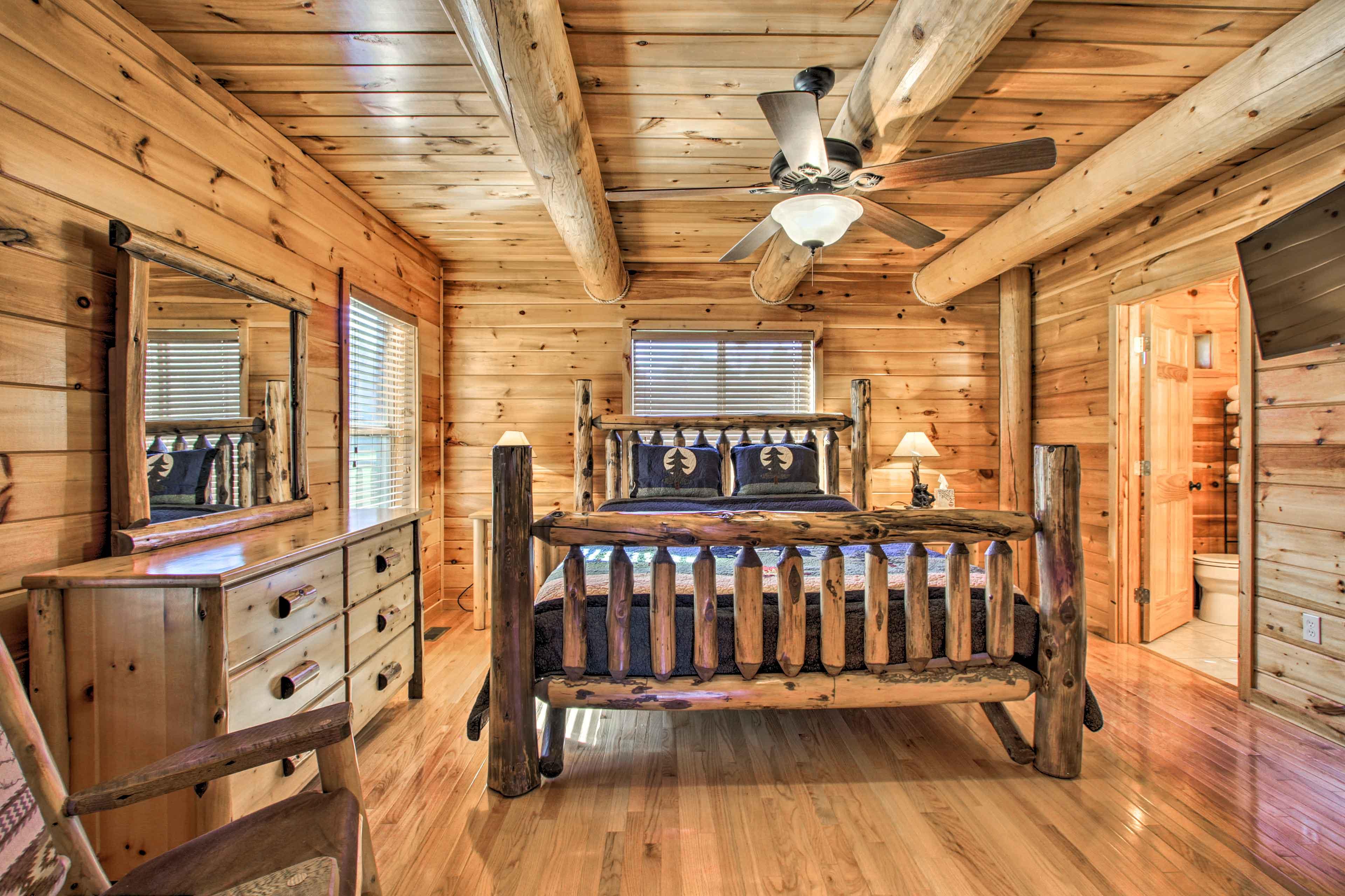 All 3 bedrooms house custom log furnishings.
