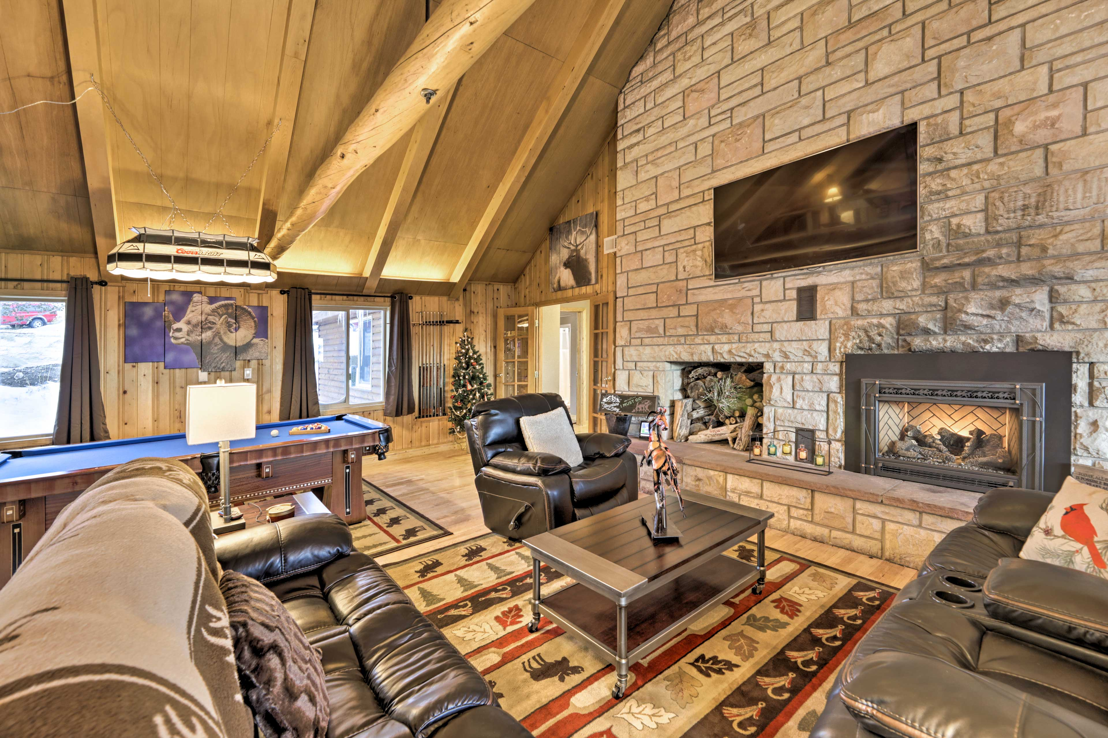 Warm up by the fireplace while you watch a movie on the flat-screen TV.