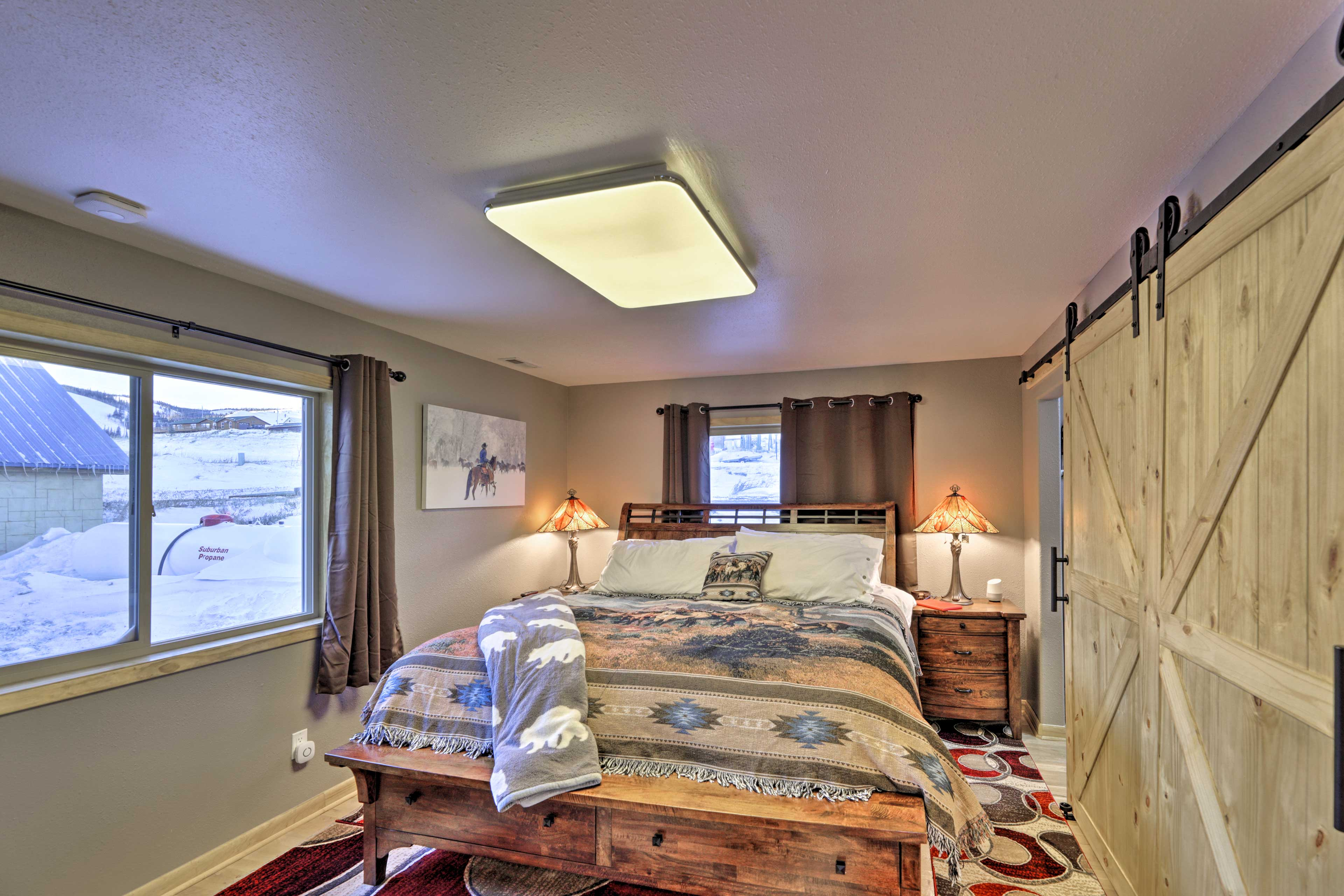 Sliding barn doors open up to the master bedroom.