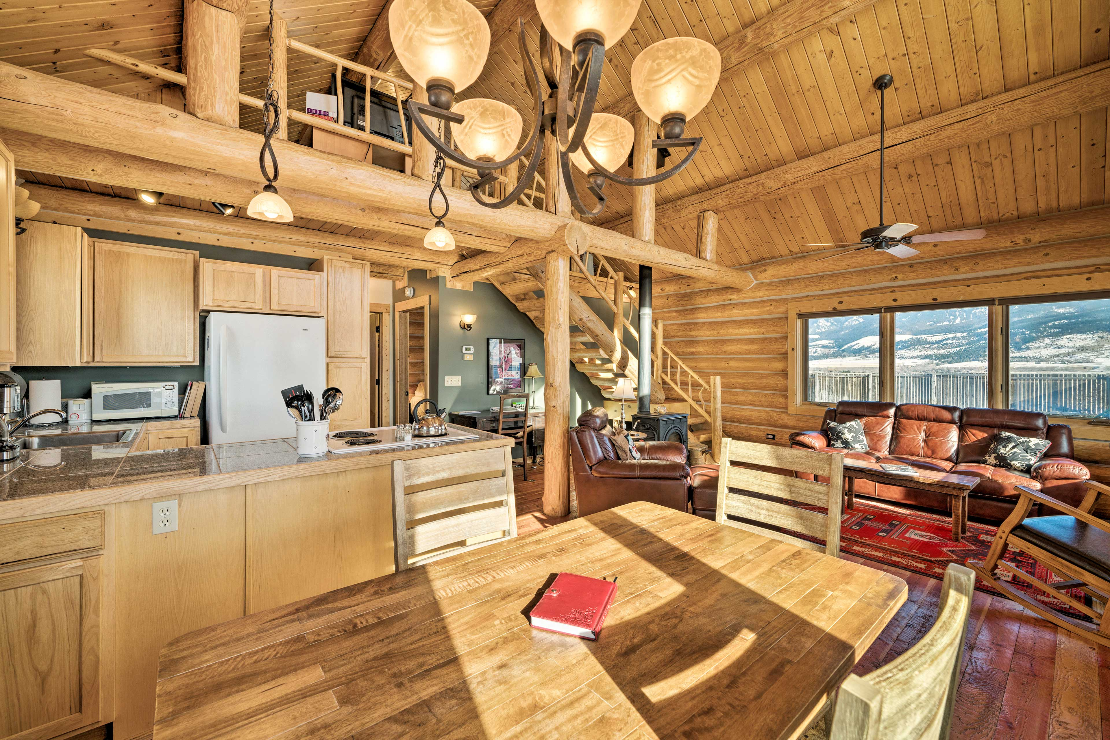 Natural log accents and vaulted ceilings highlight the open interior.