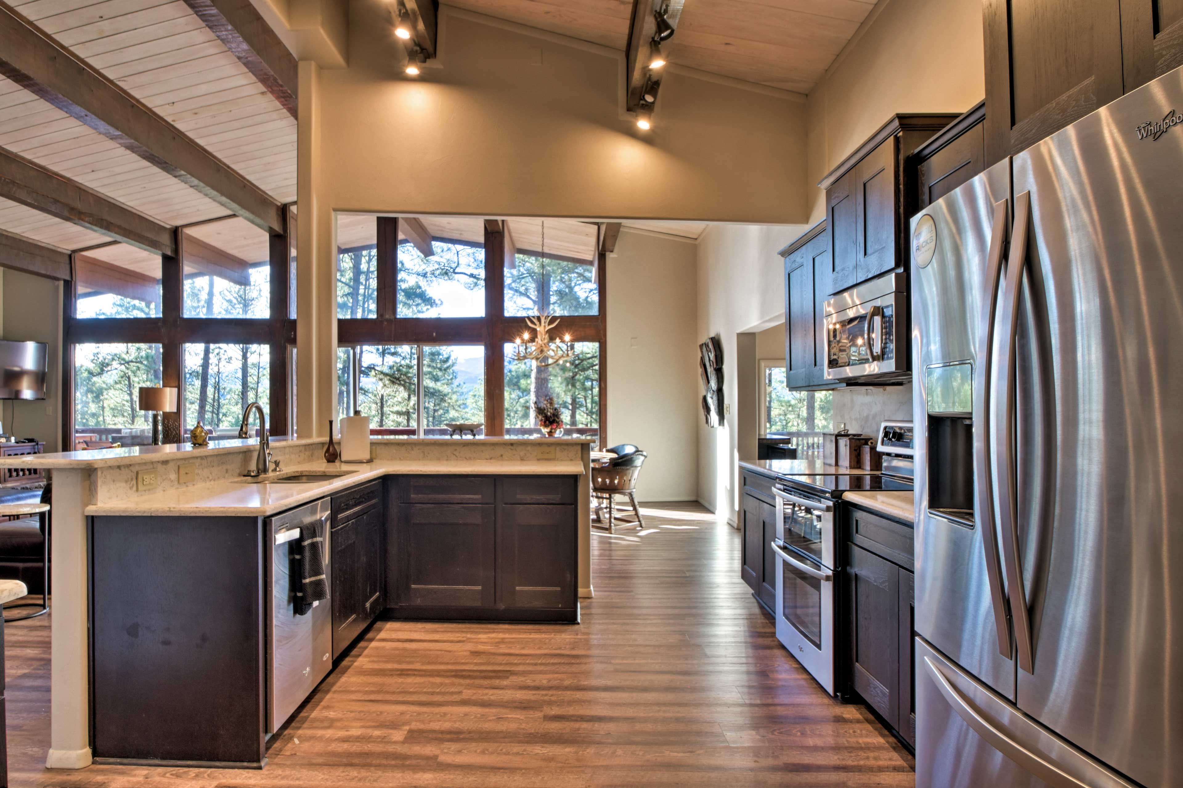 Stainless steel appliances and wooden accents detail the elegant kitchen.