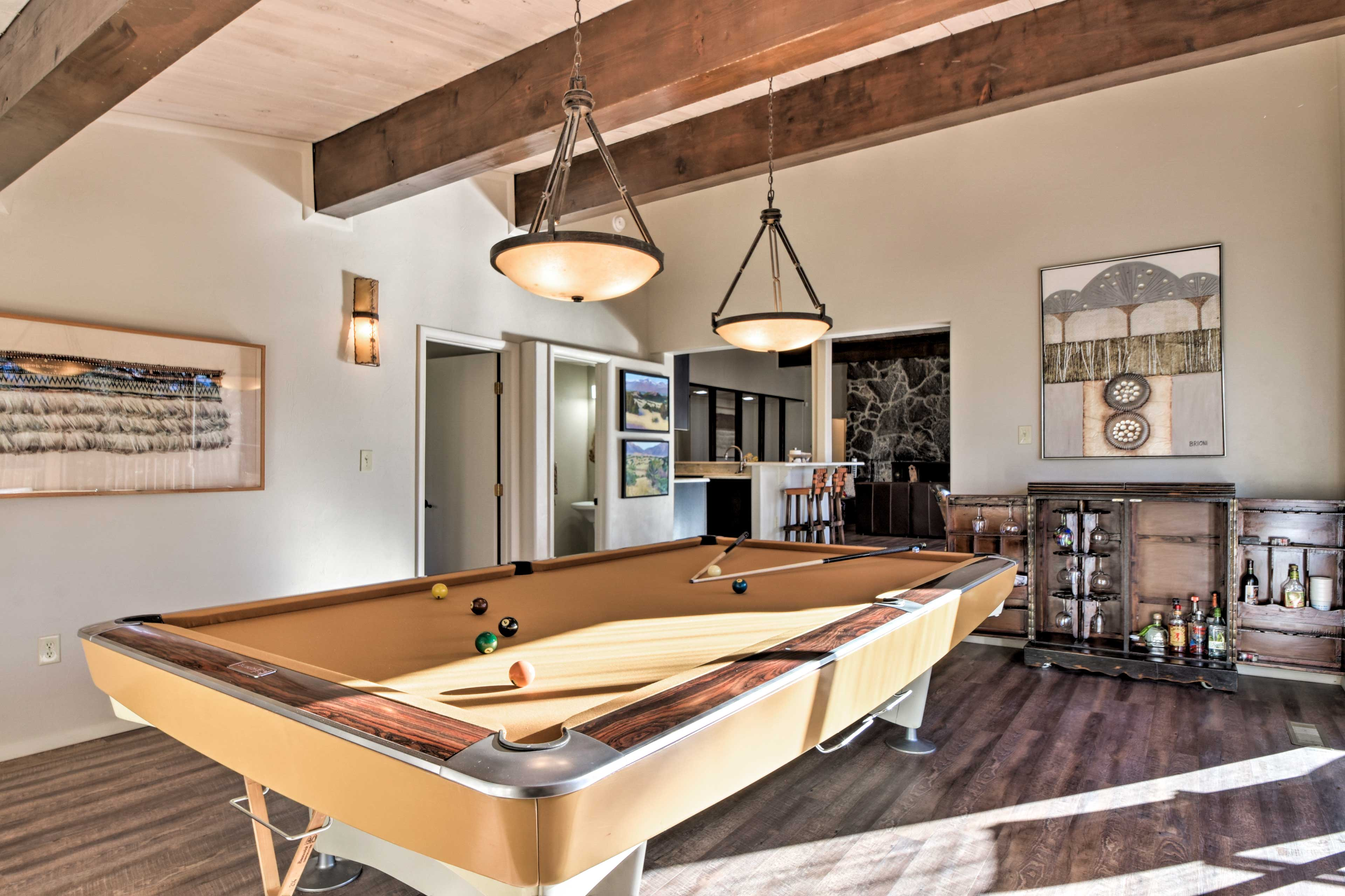 Just steps away, a Snooker table and bar area outfit this sun-soaked room.