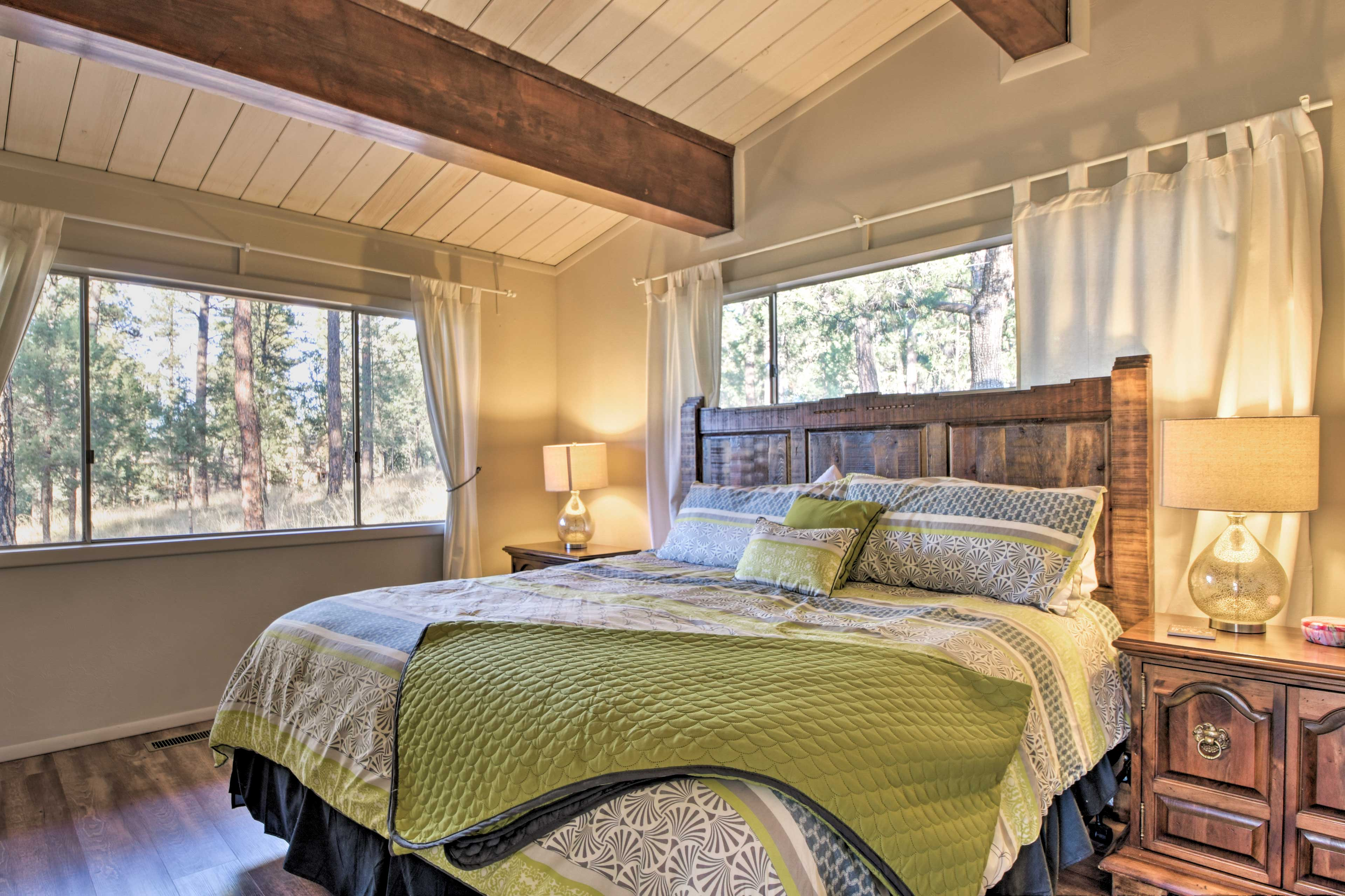 In the second master bedroom, you'll find a plush king bed!
