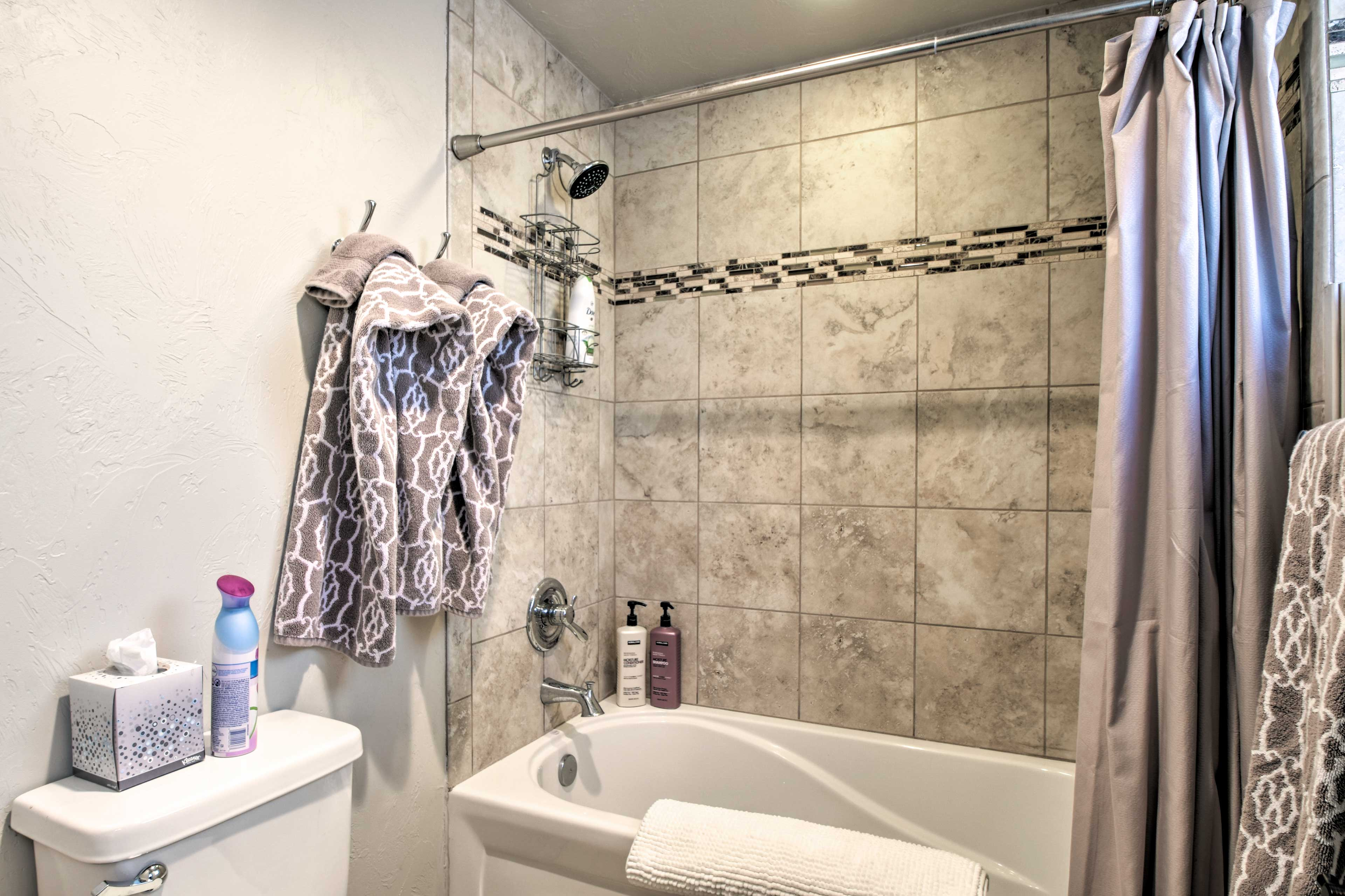 The tiled shower/tub combo completes the bathroom.