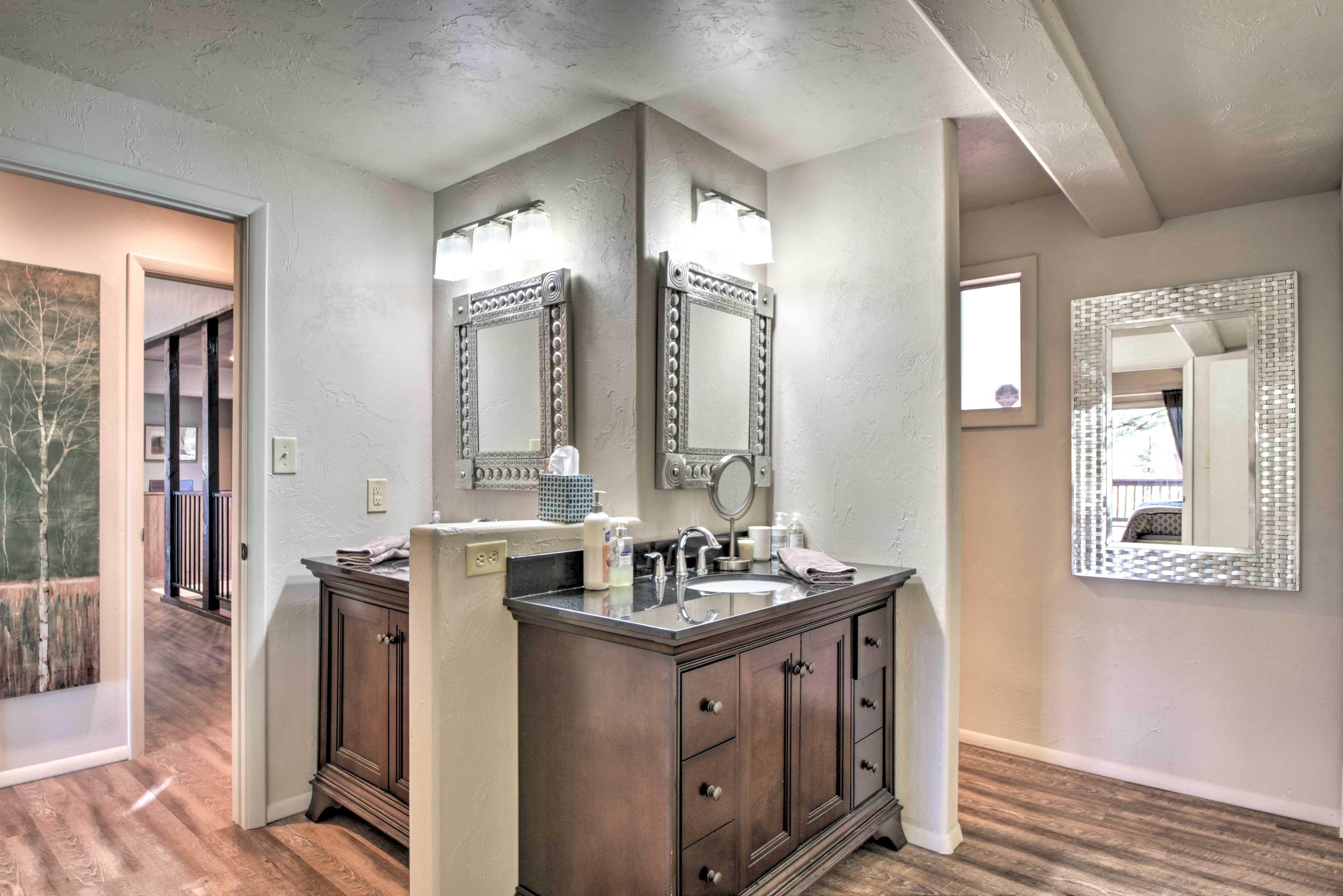 The elegant en-suite bathroom features double vanities.