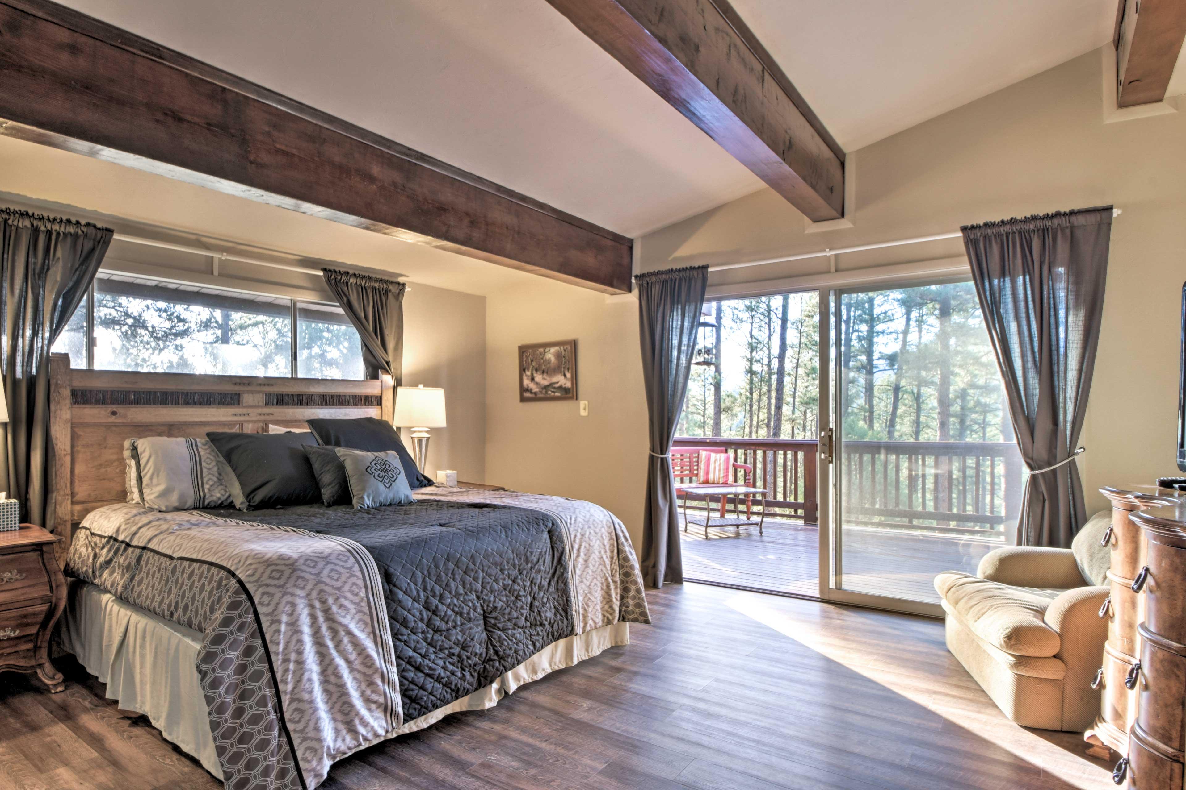 Open wood beams extend across the master bedroom.