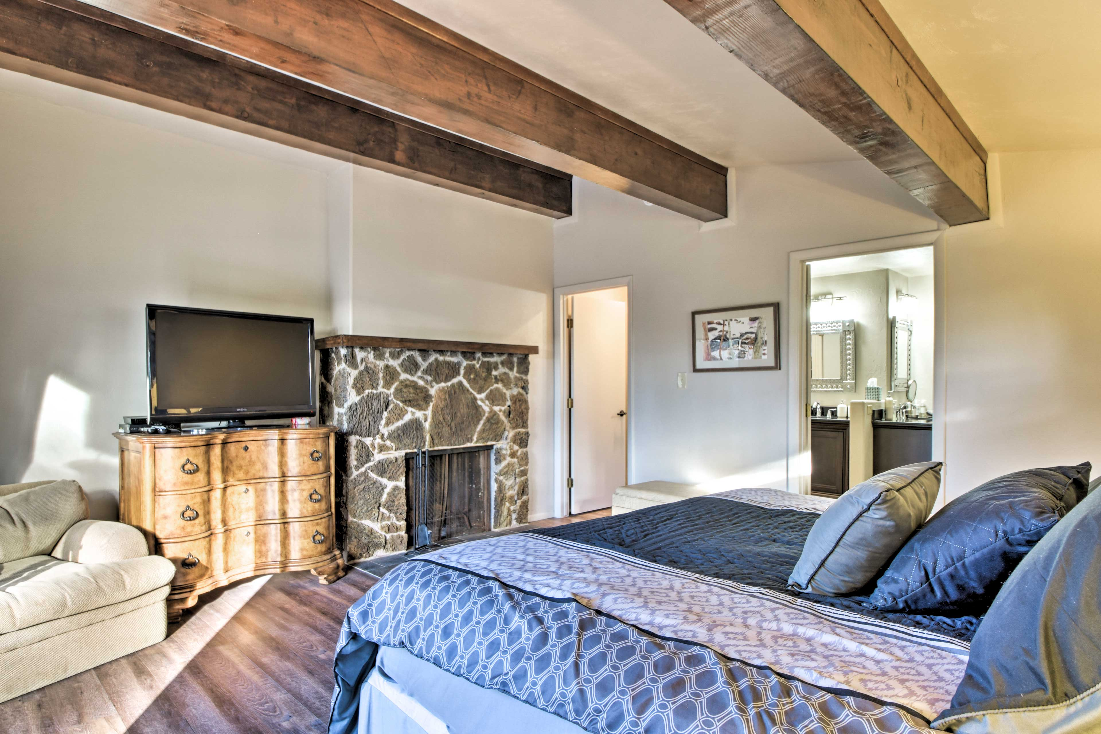 Watch a movie on the flat-screen cable TV set beside the wood-burning fireplace.