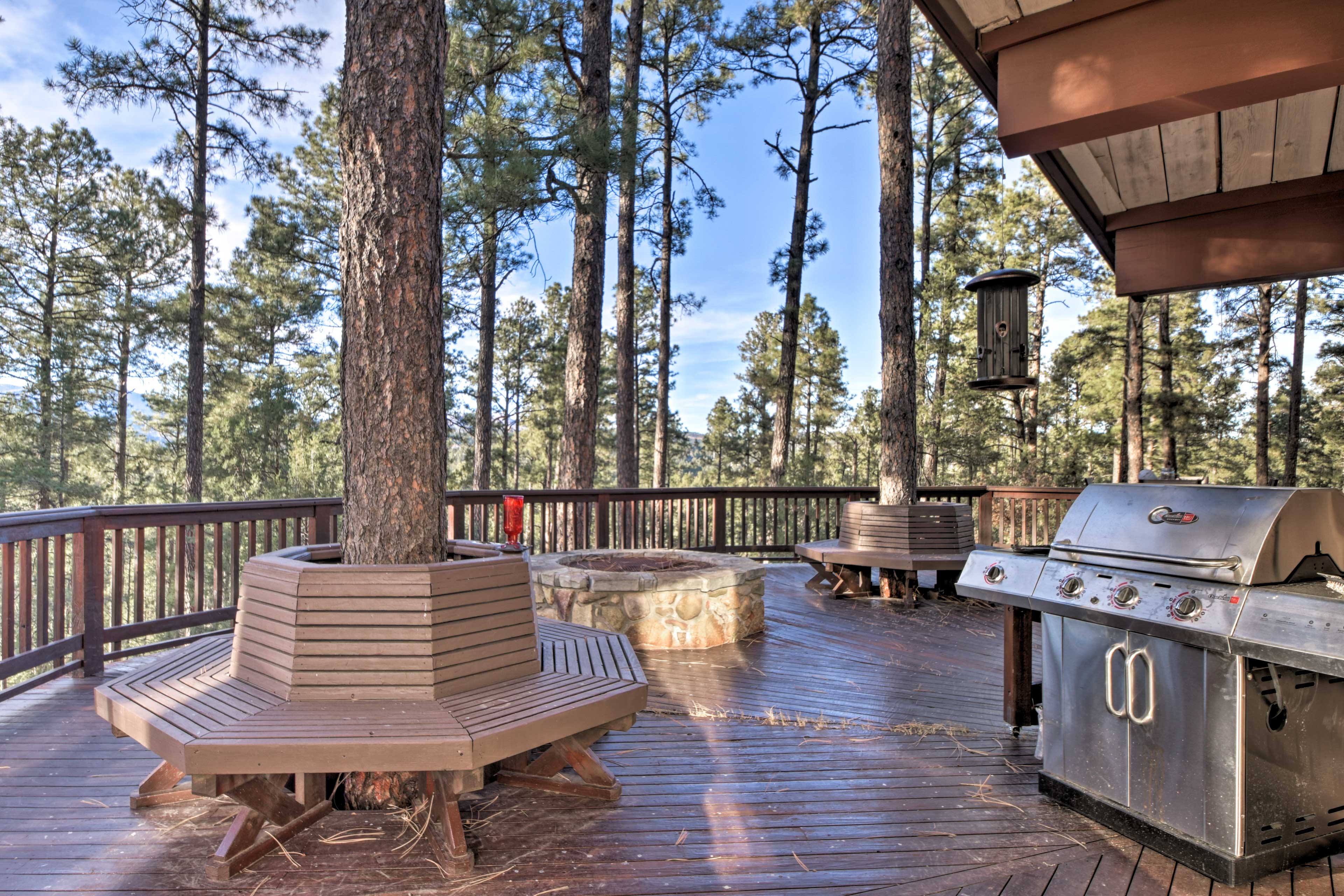 The deck features a gas grill and plenty of seating overlooking the mountains.