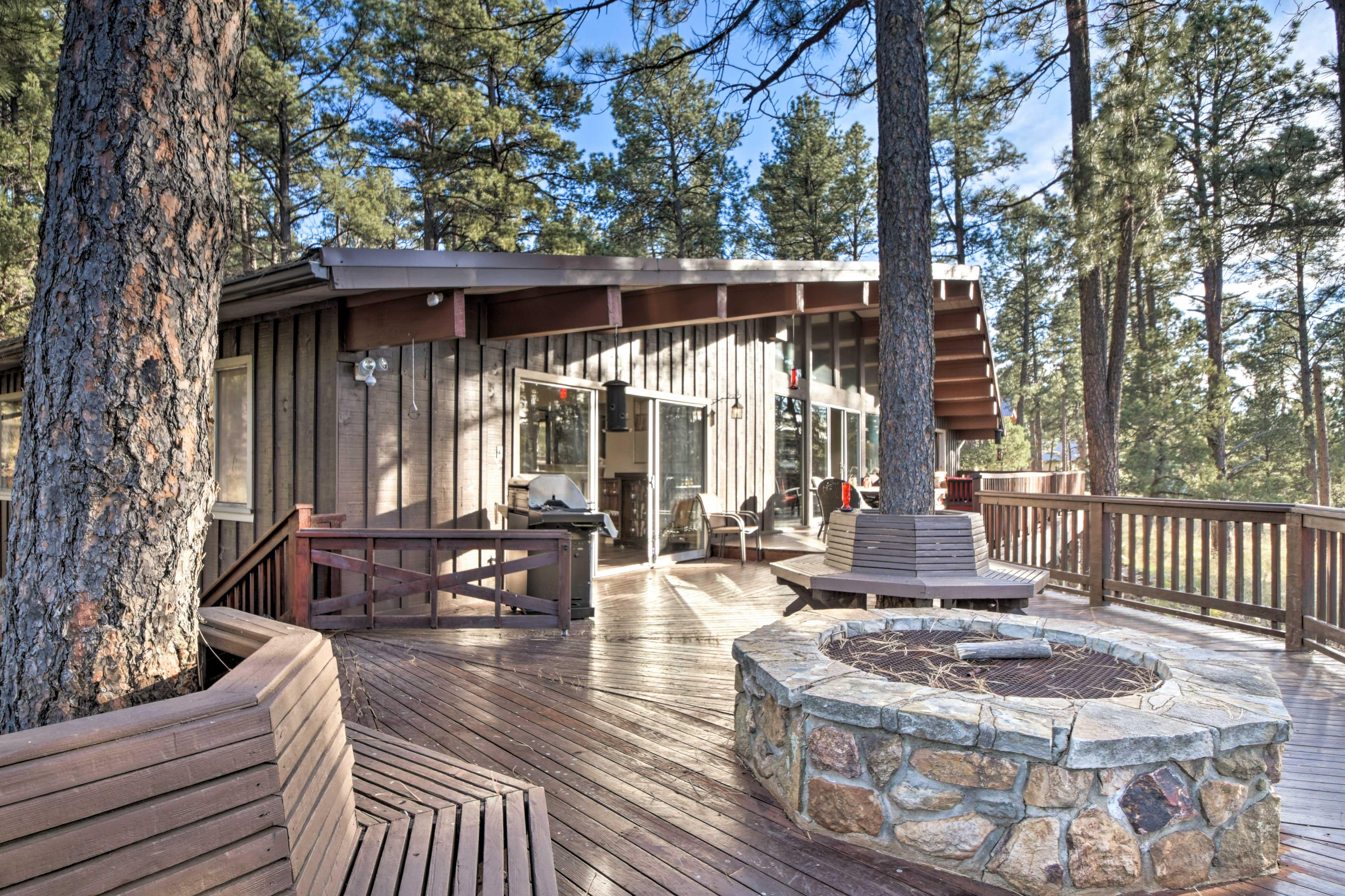 The sprawling vacation rental home boasts wraparound decks and epic views.