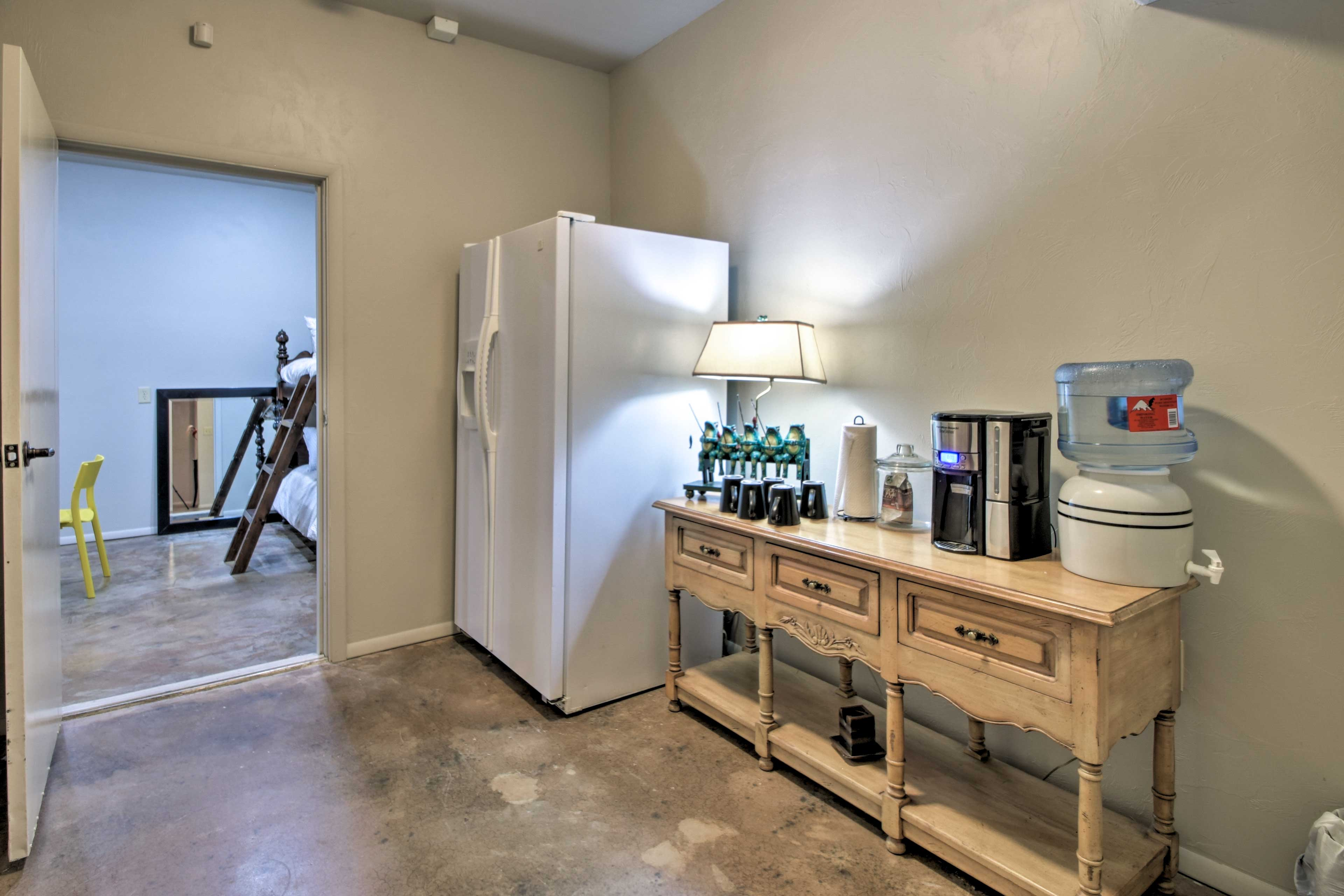 The downstairs area features water, coffee and a refrigerator!