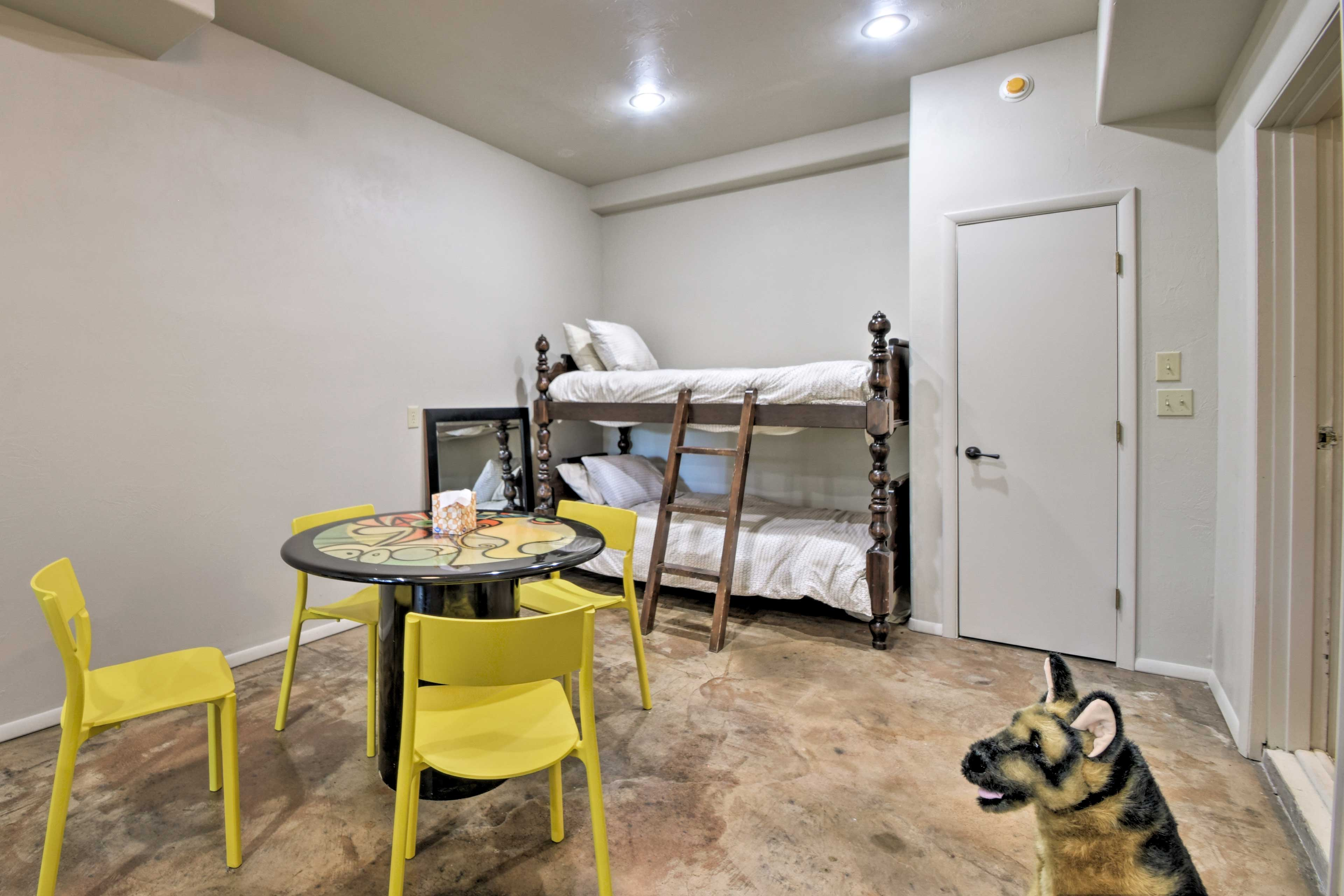 Boasting its own lounge area, the Bunk Room hosts a twin-over-twin bunk bed.