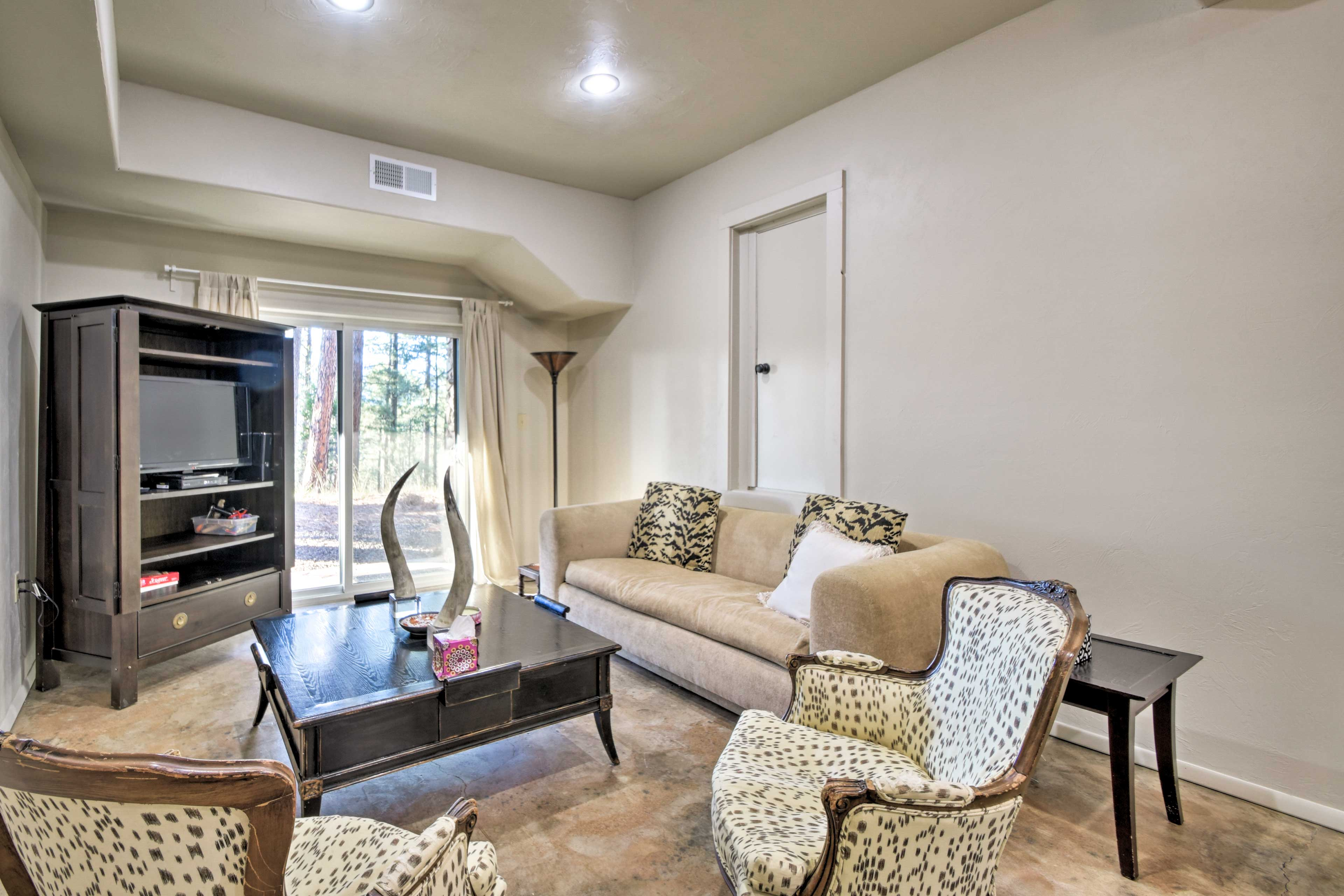 Take it easy in front of the flat-screen cable TV beside the patio access.