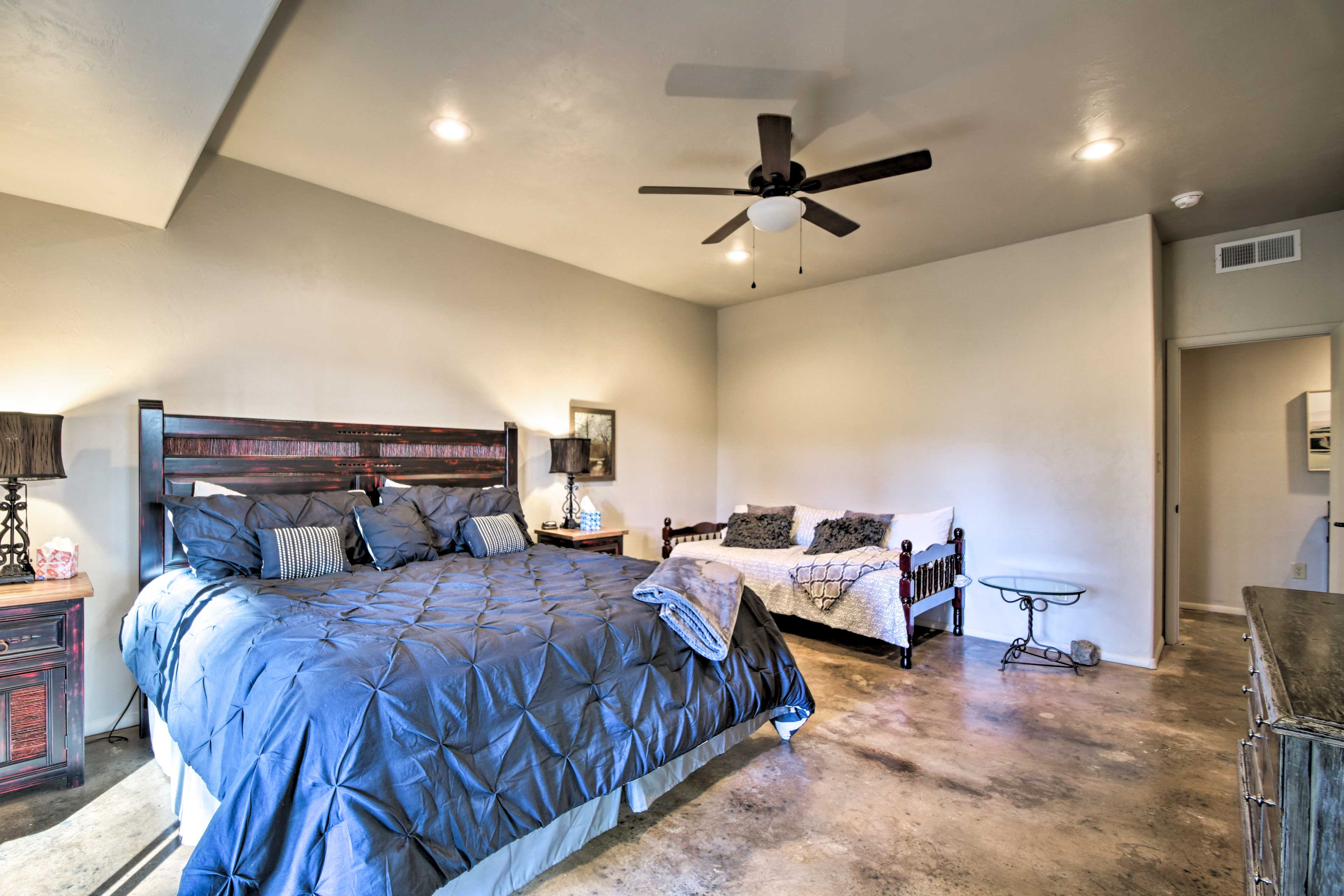 The third bedroom offers a king bed with a twin daybed