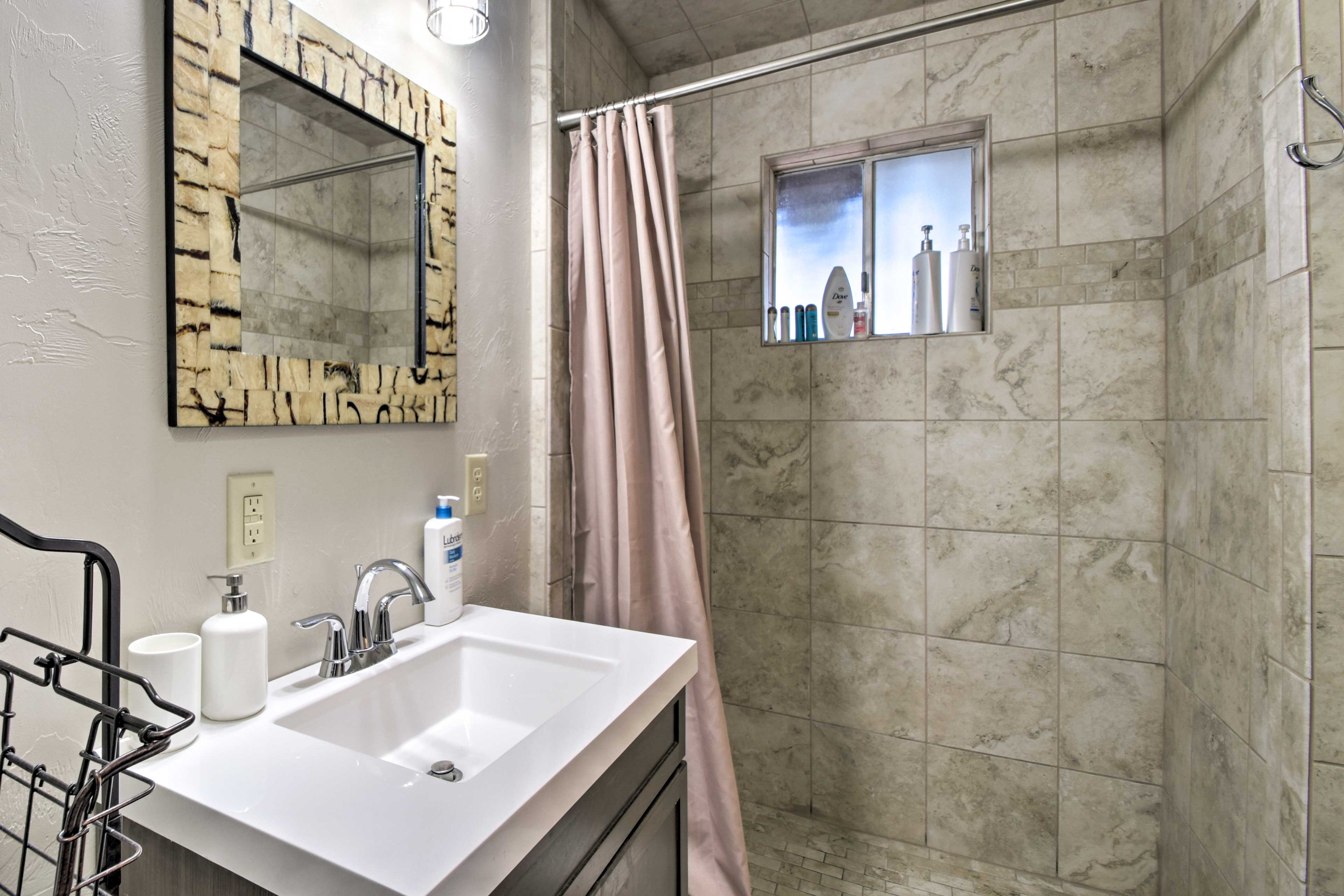 After a day on the slopes, shower off in this spacious bathroom.