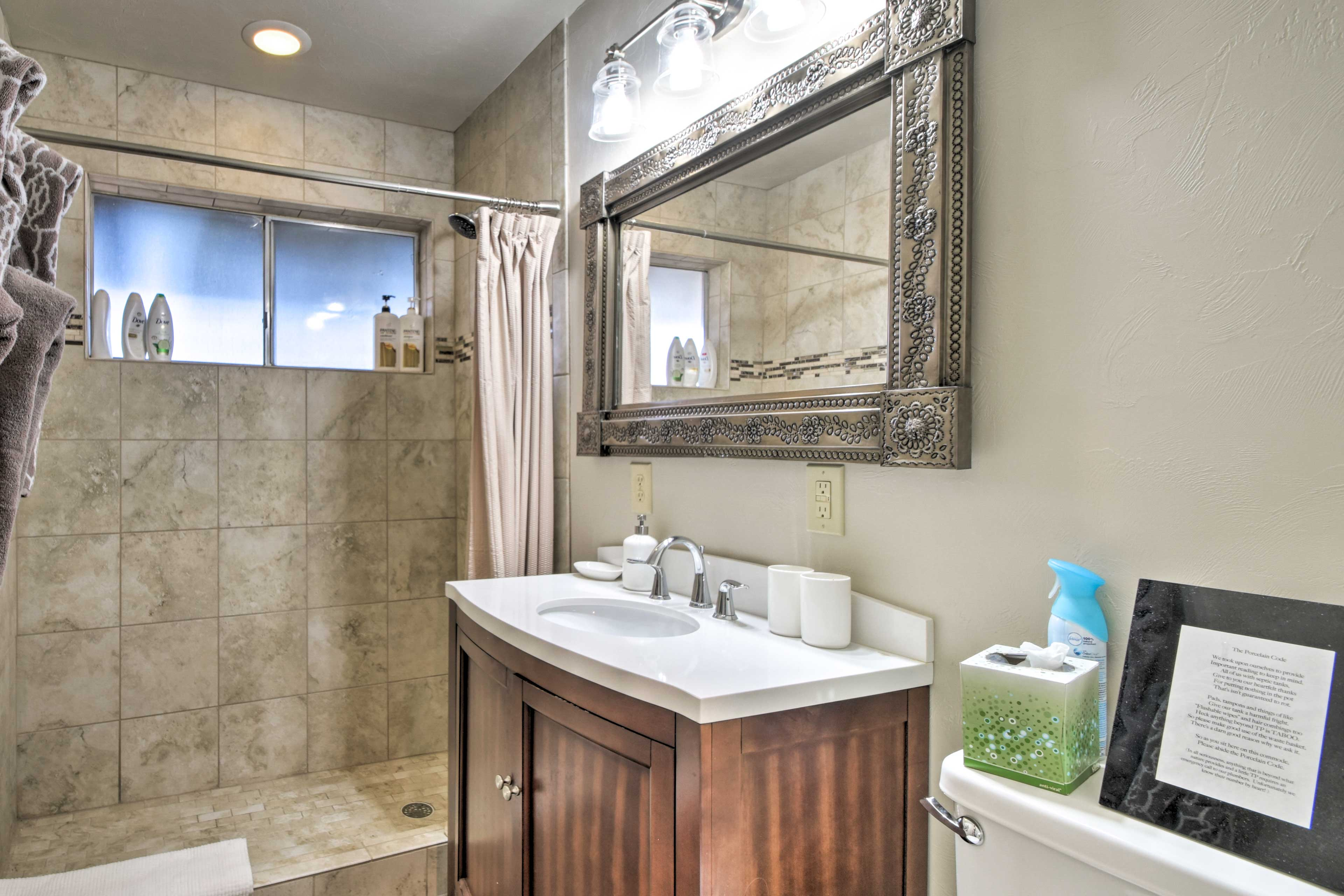 The bathrooms features complimentary toiletries and soft towels.