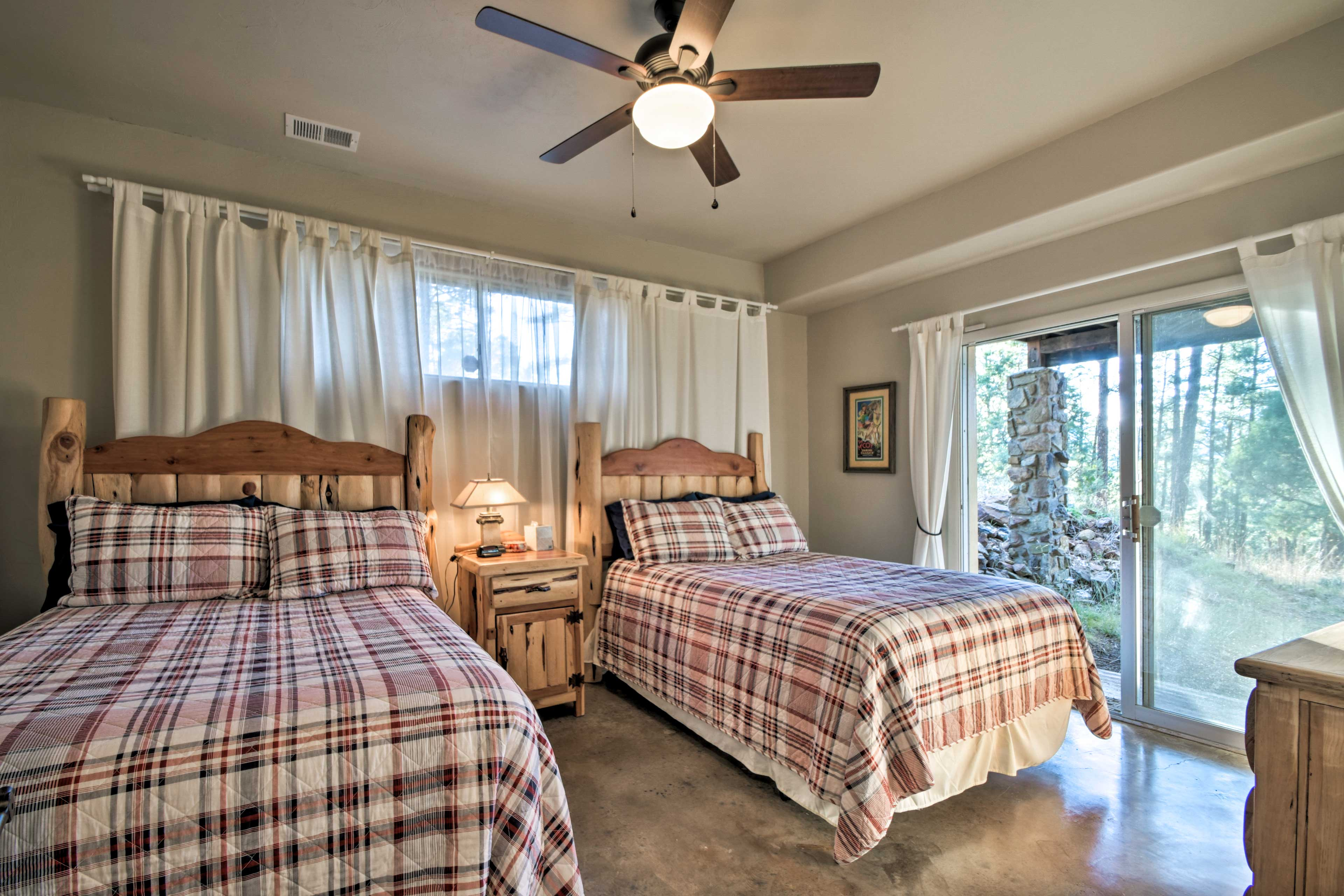 Aptly named, the plaid room boasts 2 full beds topped with soft bedding.