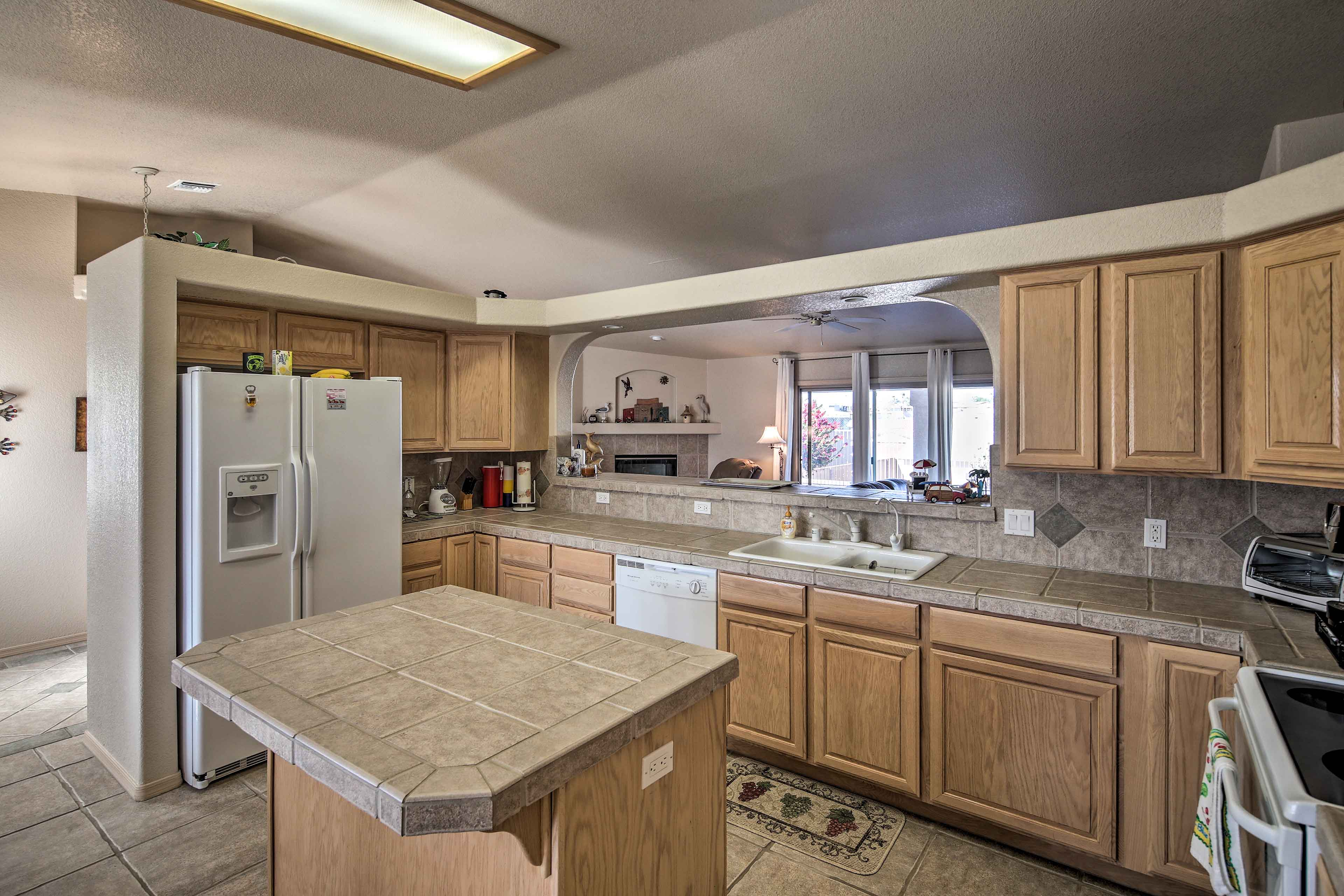 The family room opens into the kitchen through a large breakfast bar.