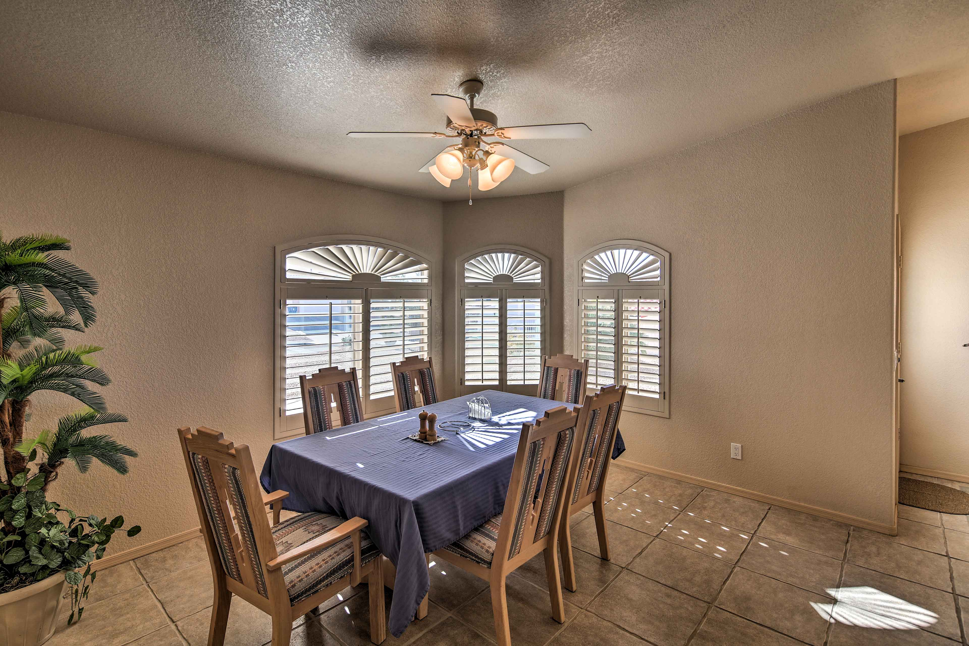 Enjoy home-cooked meals at the large dining table.