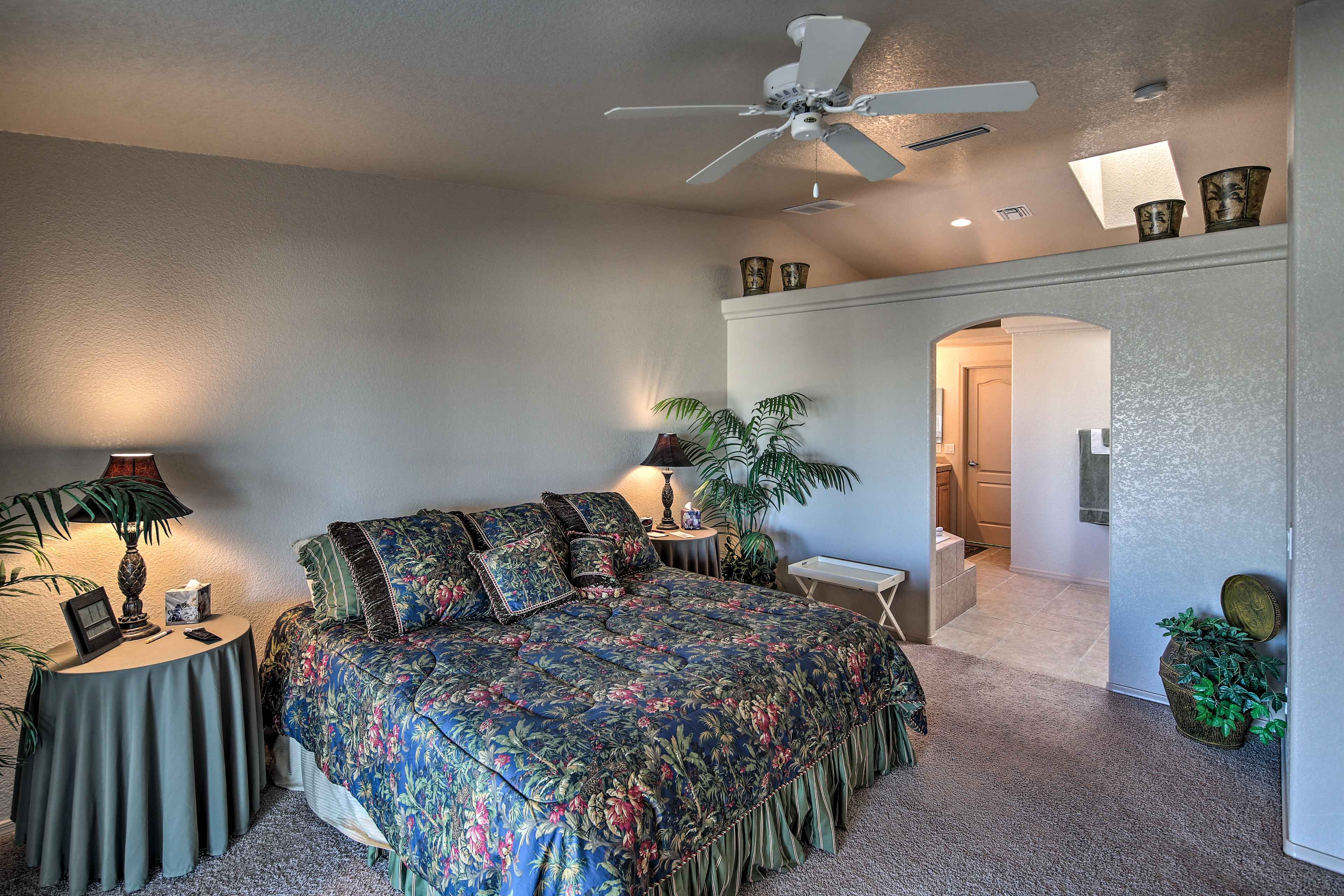 Enjoy a restful night in the master bedroom.