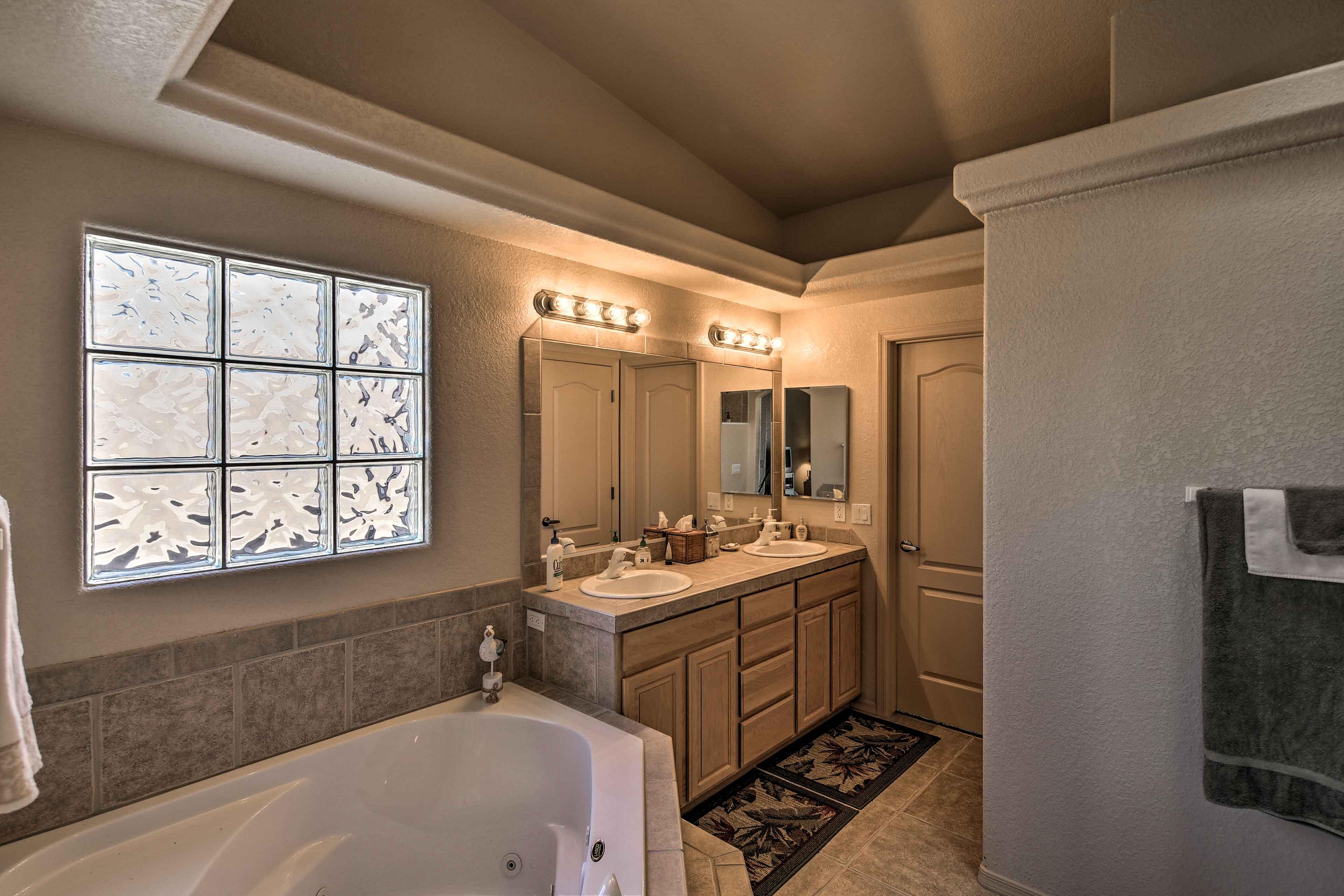 The master en-suite bathroom boasts a large Jacuzzi tub.