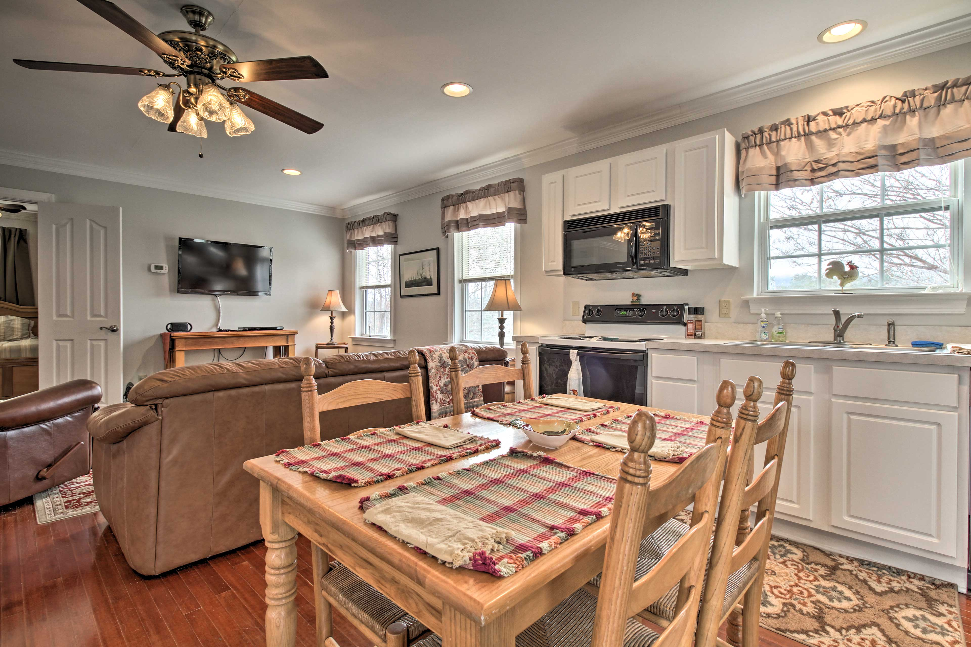Gleaming hardwood floors and all of the comforts of home furnish the apartment.