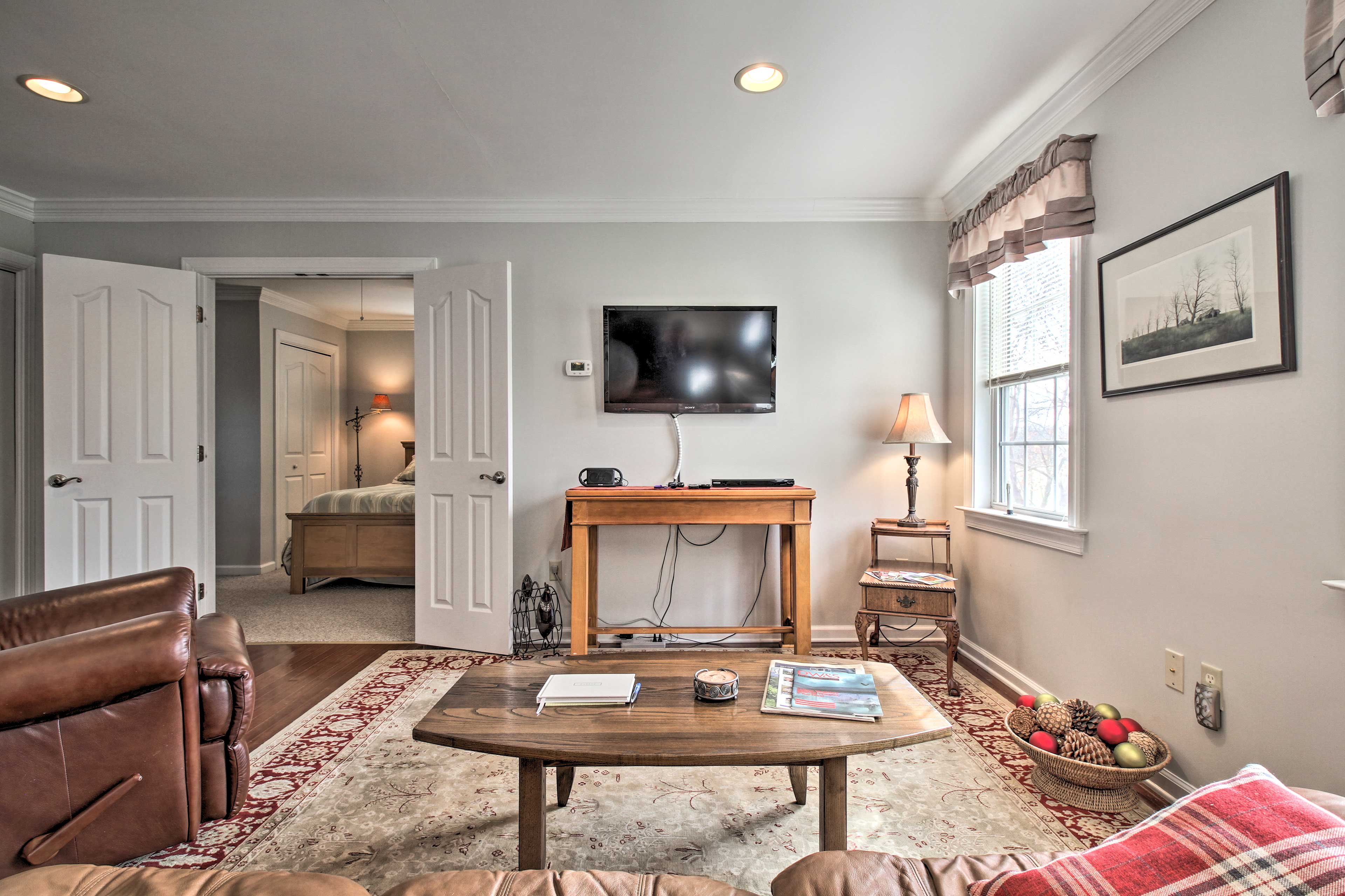 Settle into the comfortable furnishings across from the flat-screen cable TV.