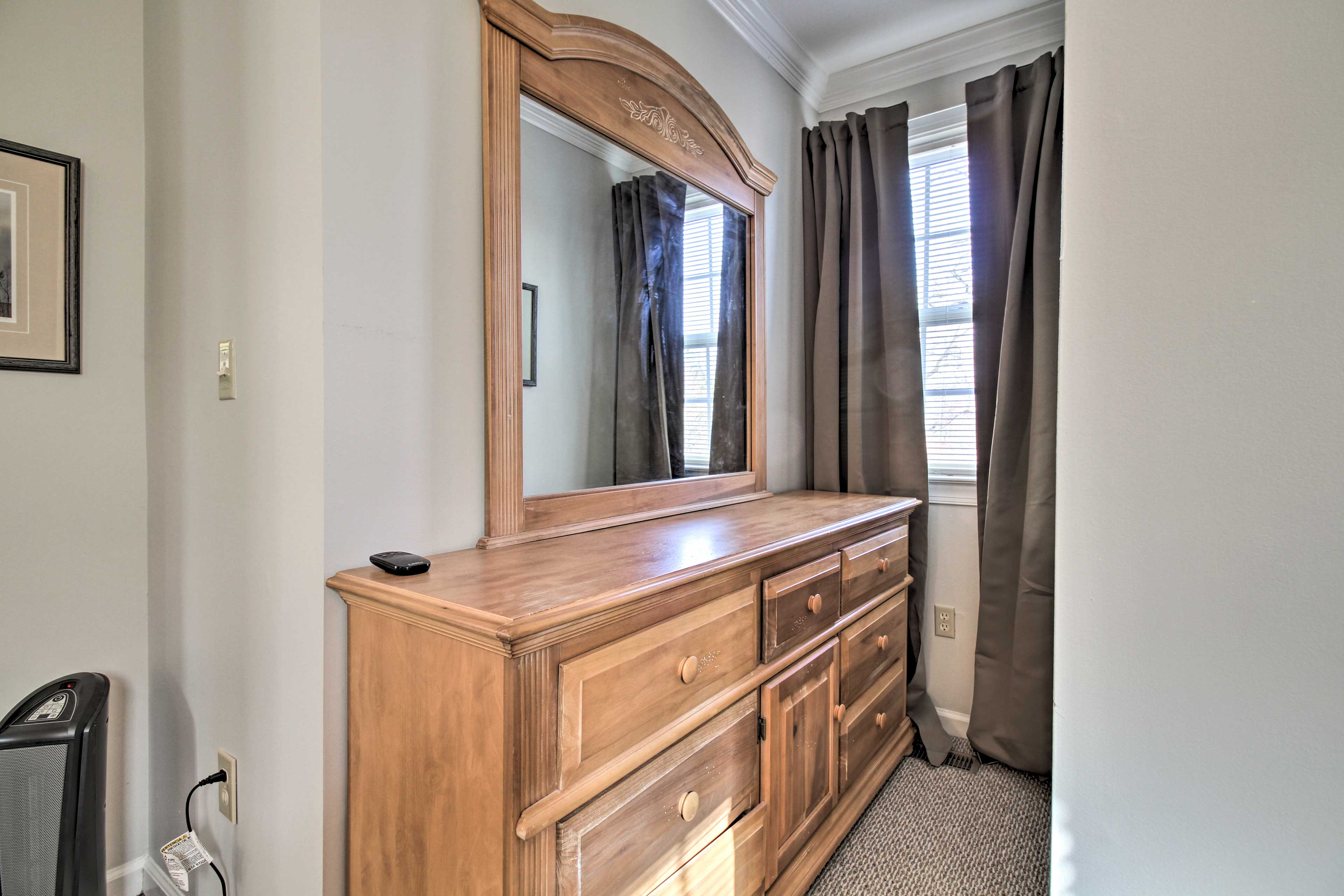 Use the mirror at the dresser to get ready for an exciting night out.