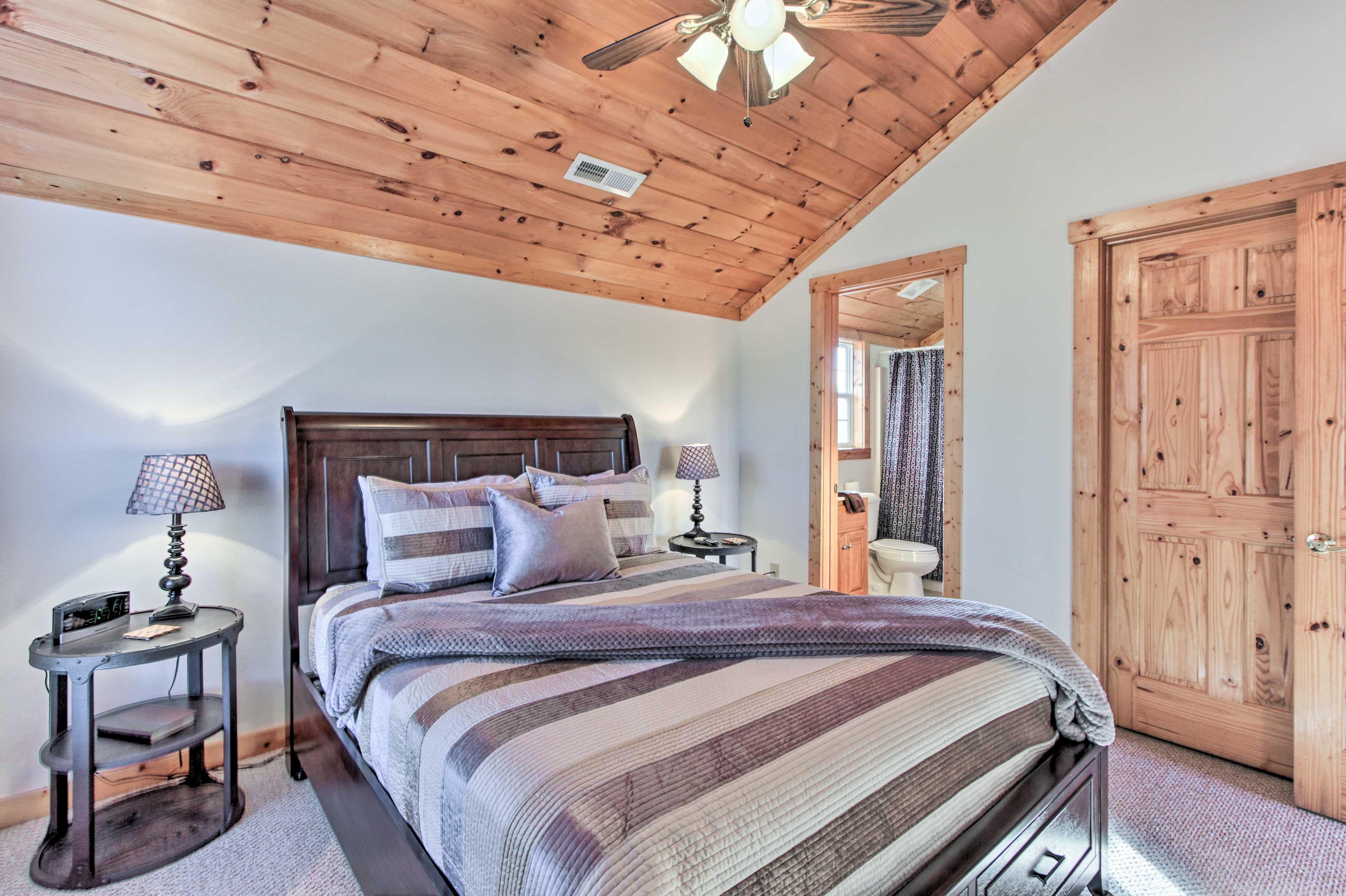 It features a queen bed and an en-suite bathroom.