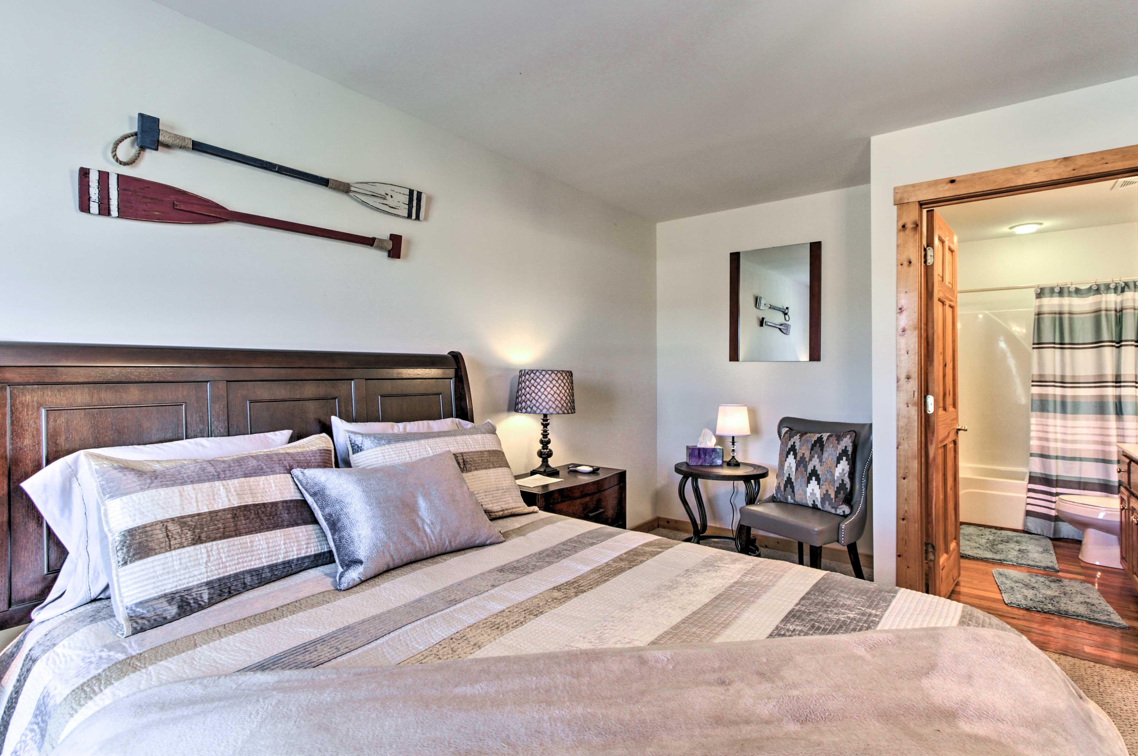 This spacious bedroom features a private en-suite bathroom.