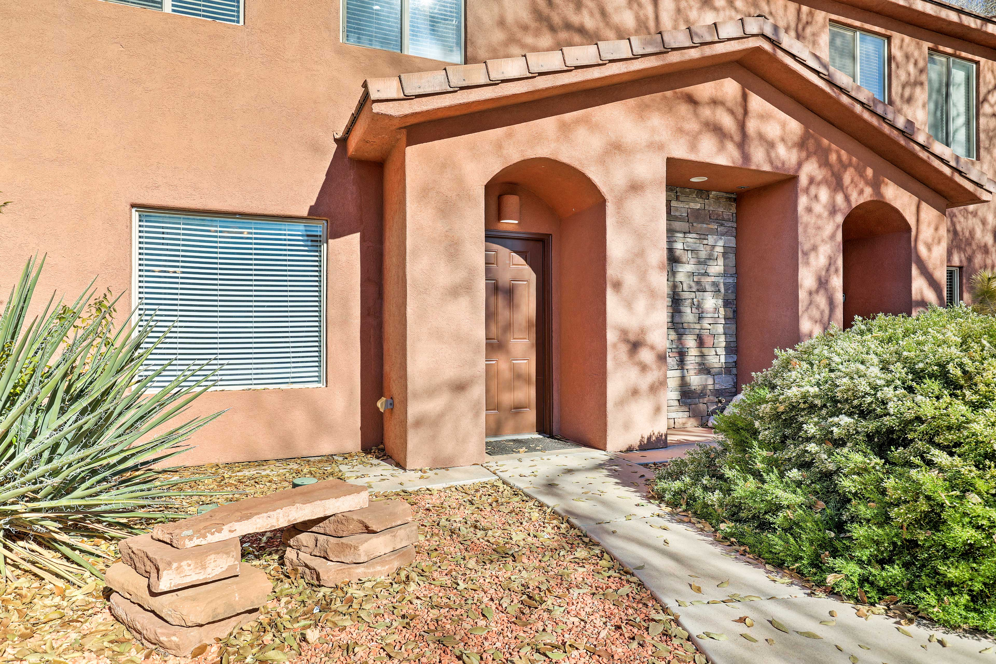 This updated home is located in 'El Pueblo Townhomes.'
