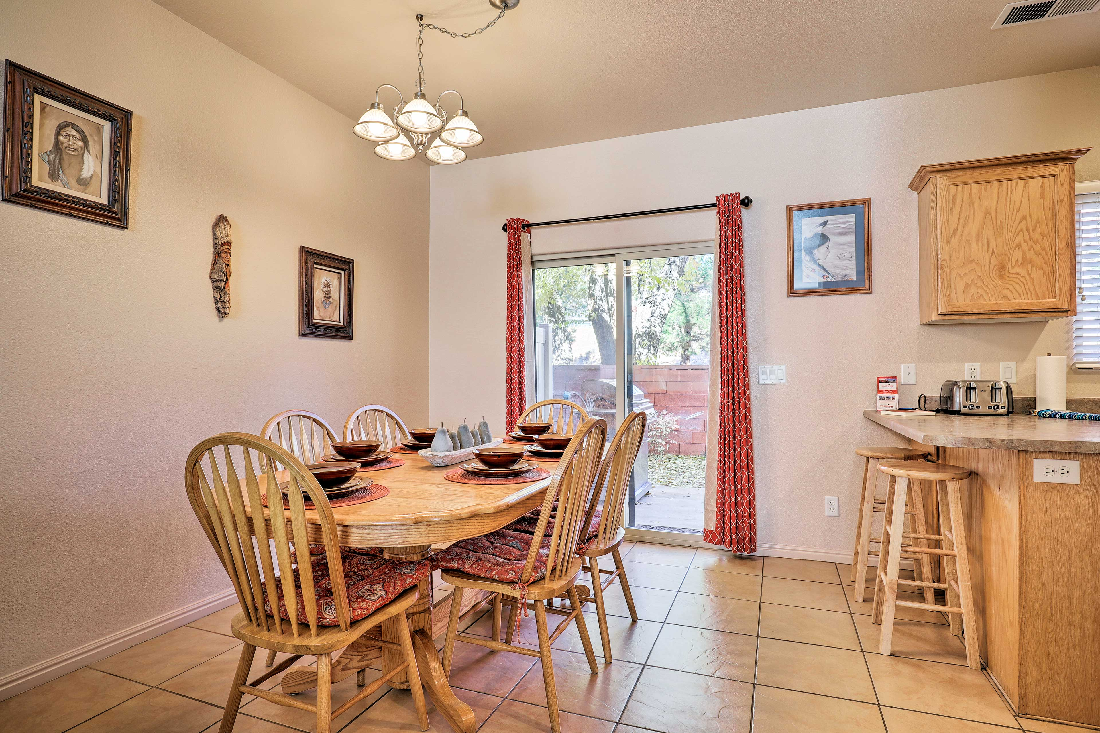 Gather the group for a family dinner around the rustic dining table.