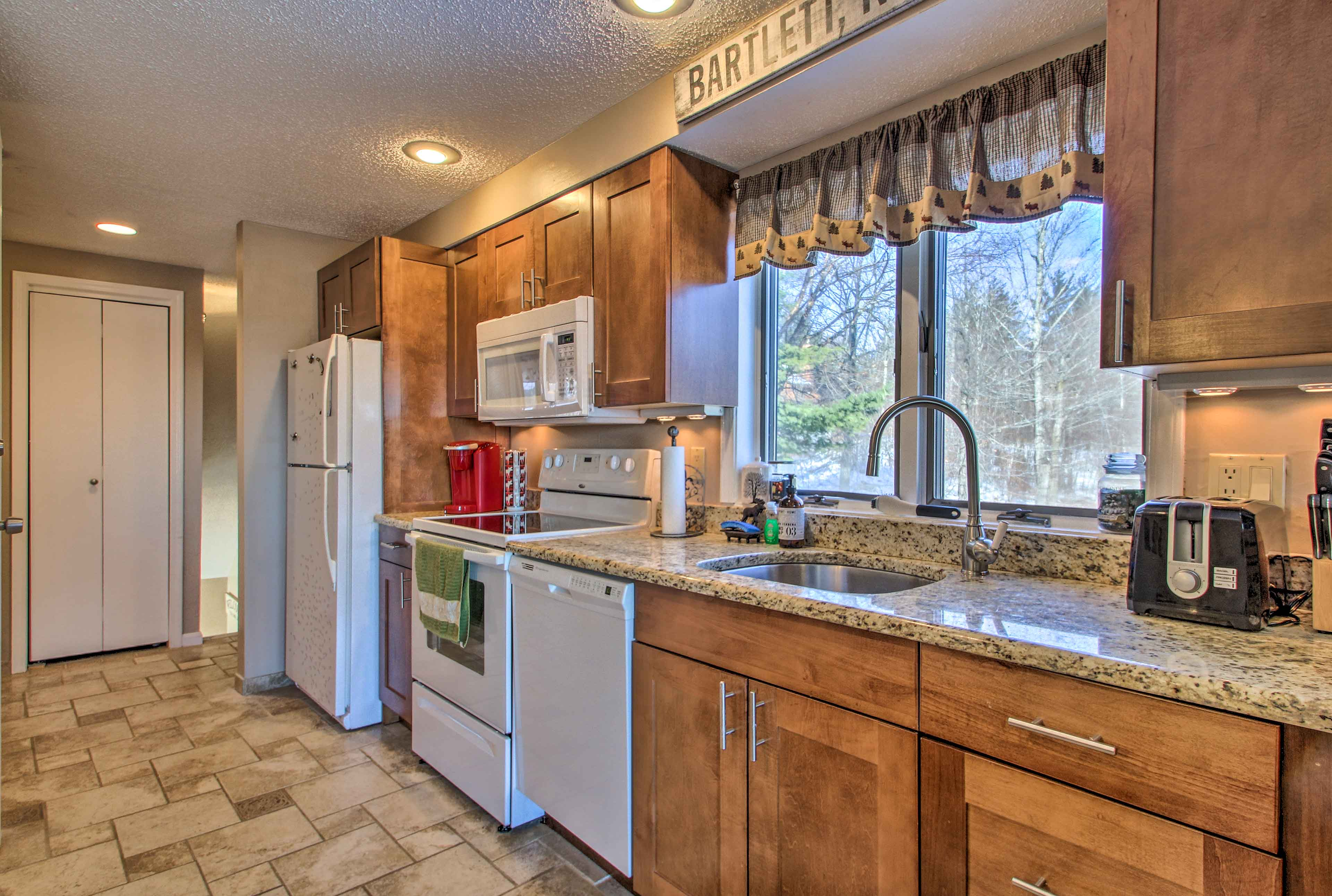 The kitchen boasts everything from a Keurig to a toaster!