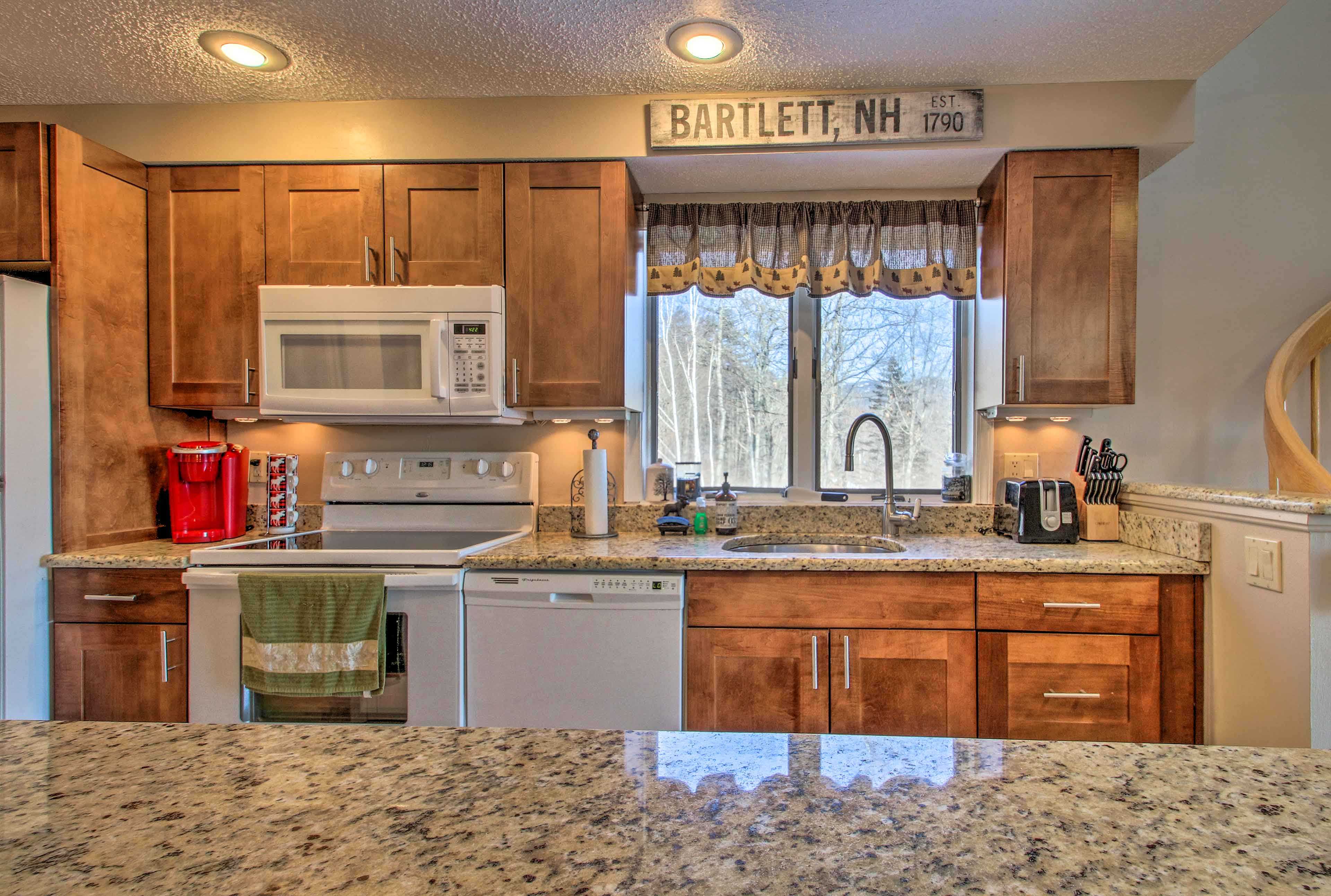 Granite counters outfit the fully equipped kitchen.