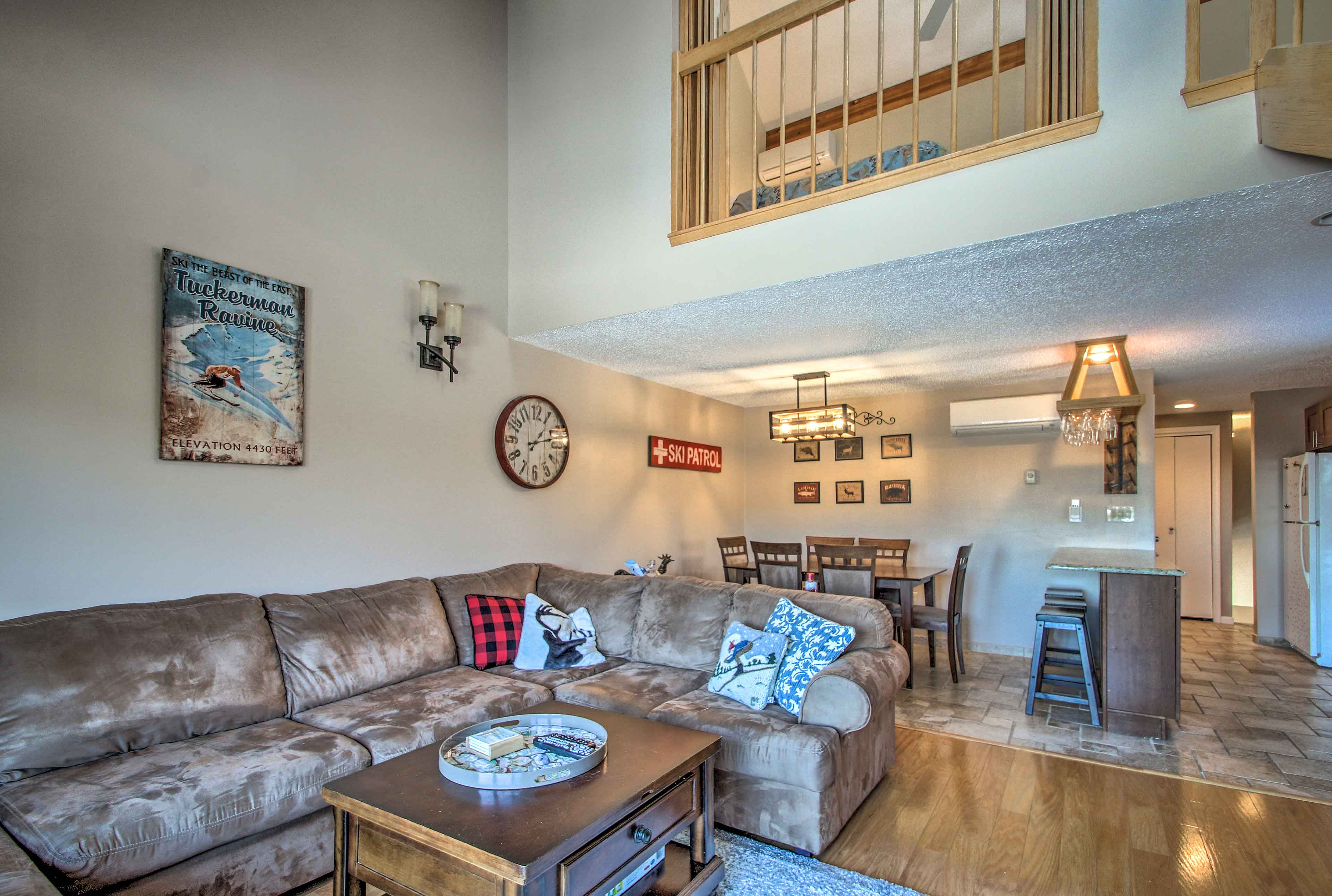 Vaulted ceilings and rustic mountain decor create a cozy space.