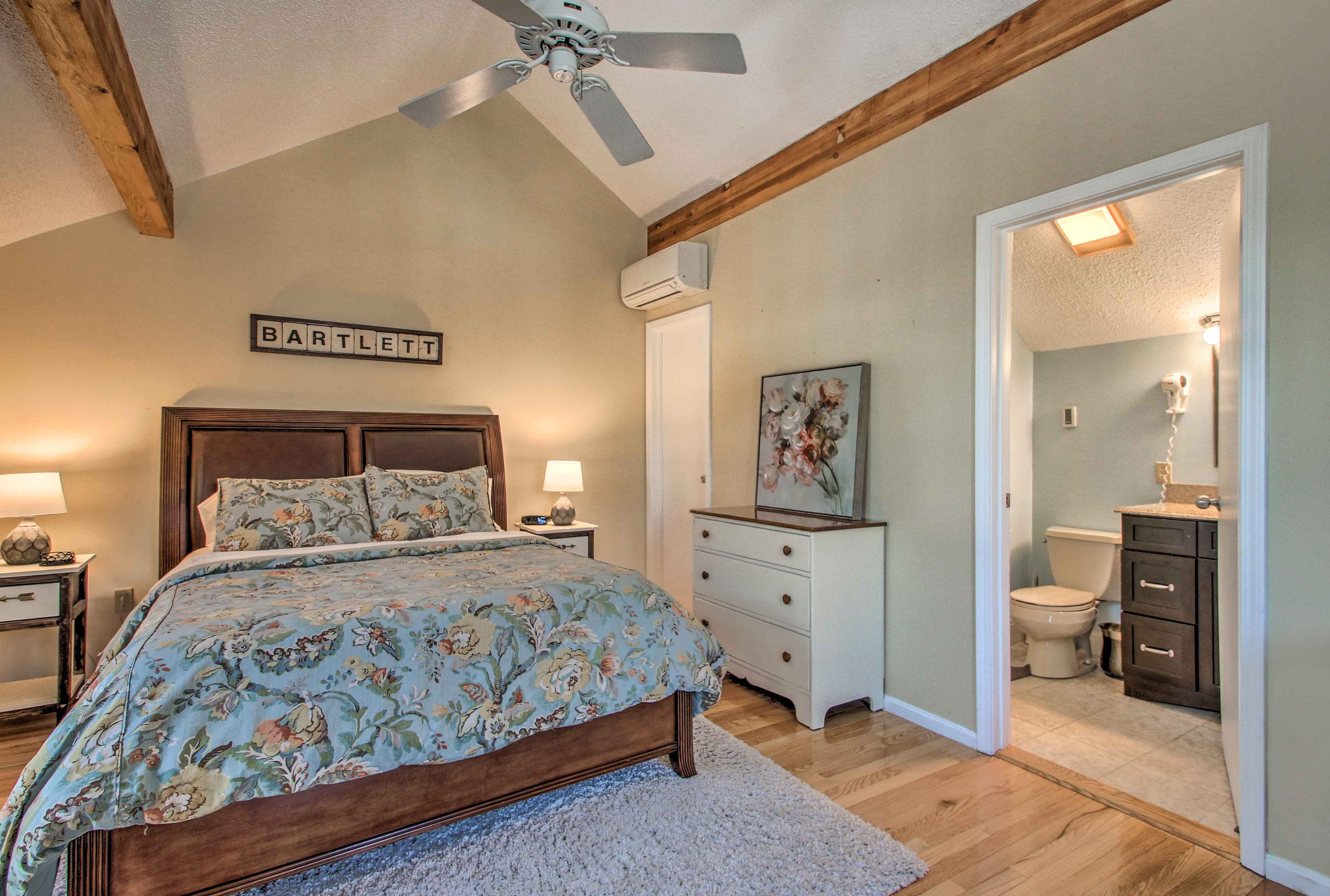 Take the spiral staircase to this charming bedroom upstairs!