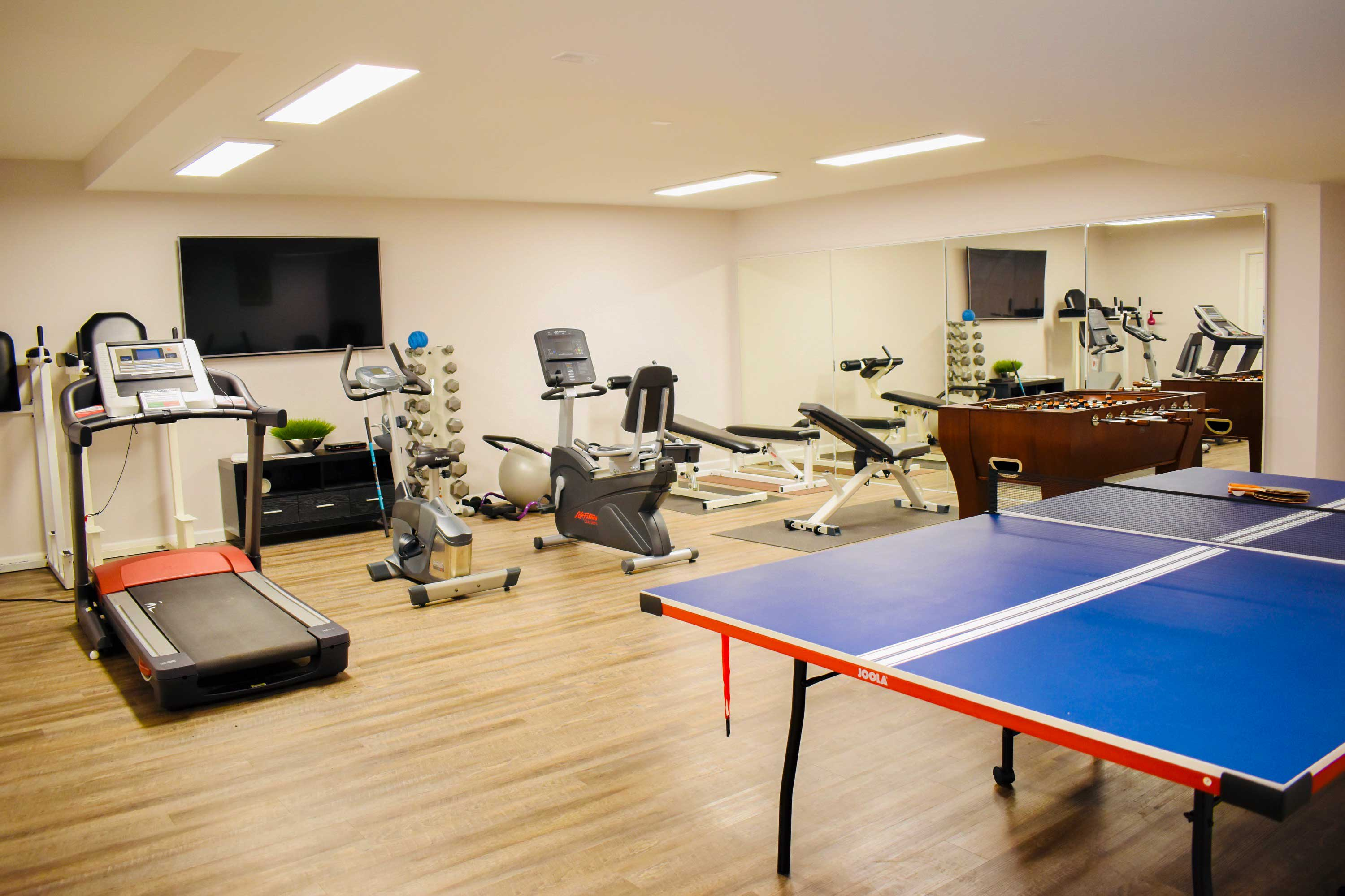 Get your workout on in the well-equipped basement fitness room.