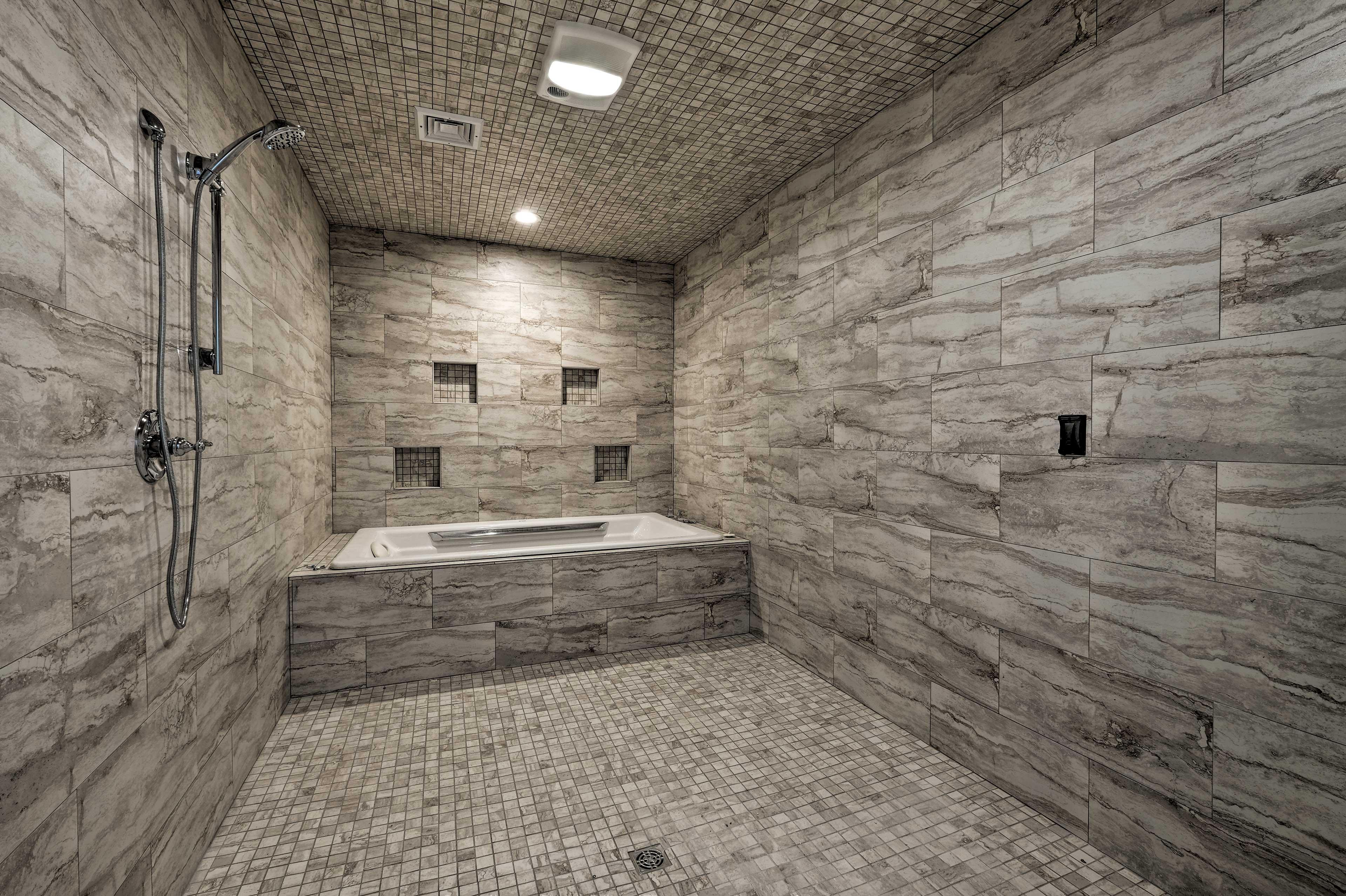 Bathroom 1: shower head, bathtub