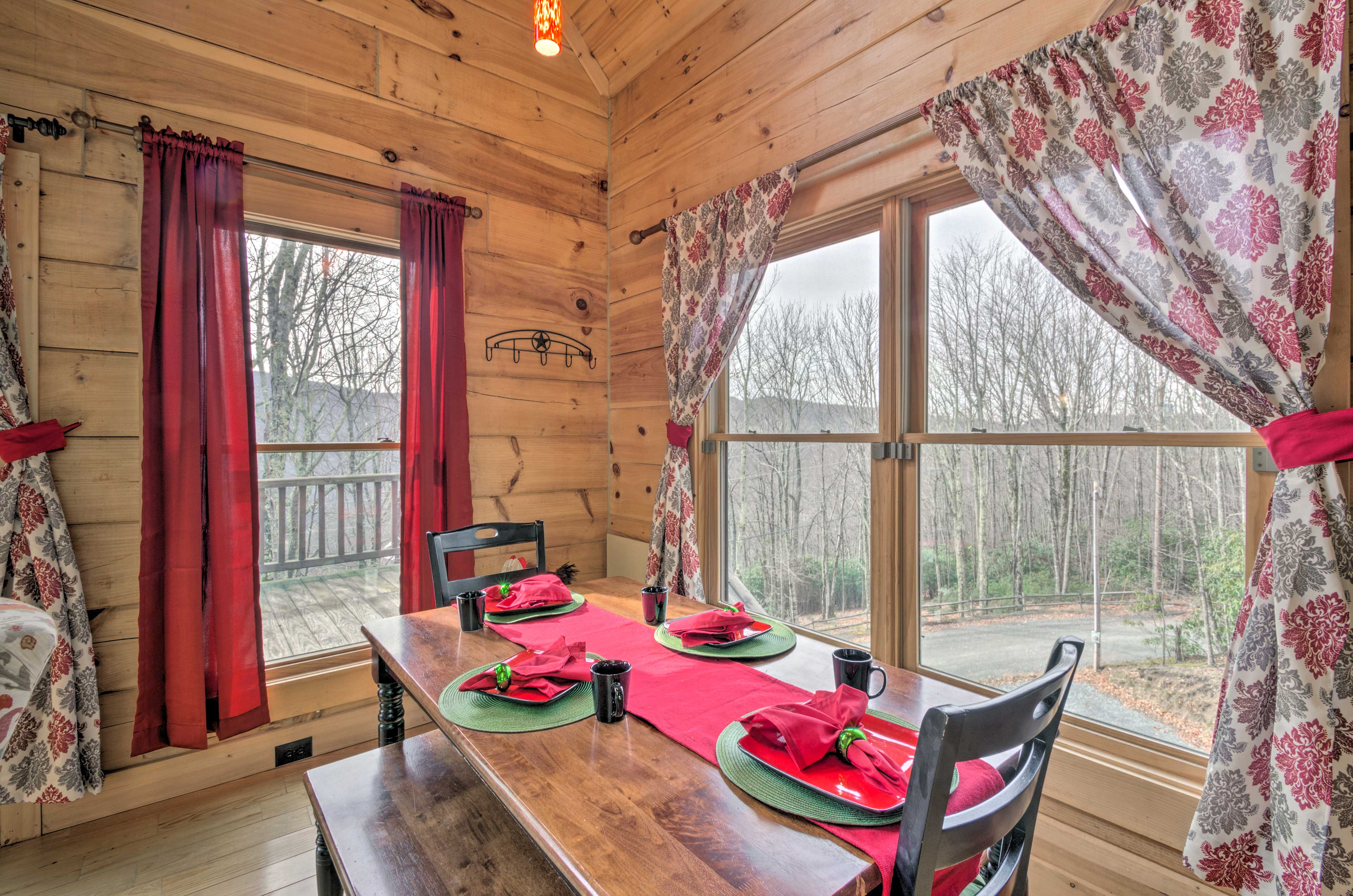 Dine in style at this 6-person table set beside the mountain views.