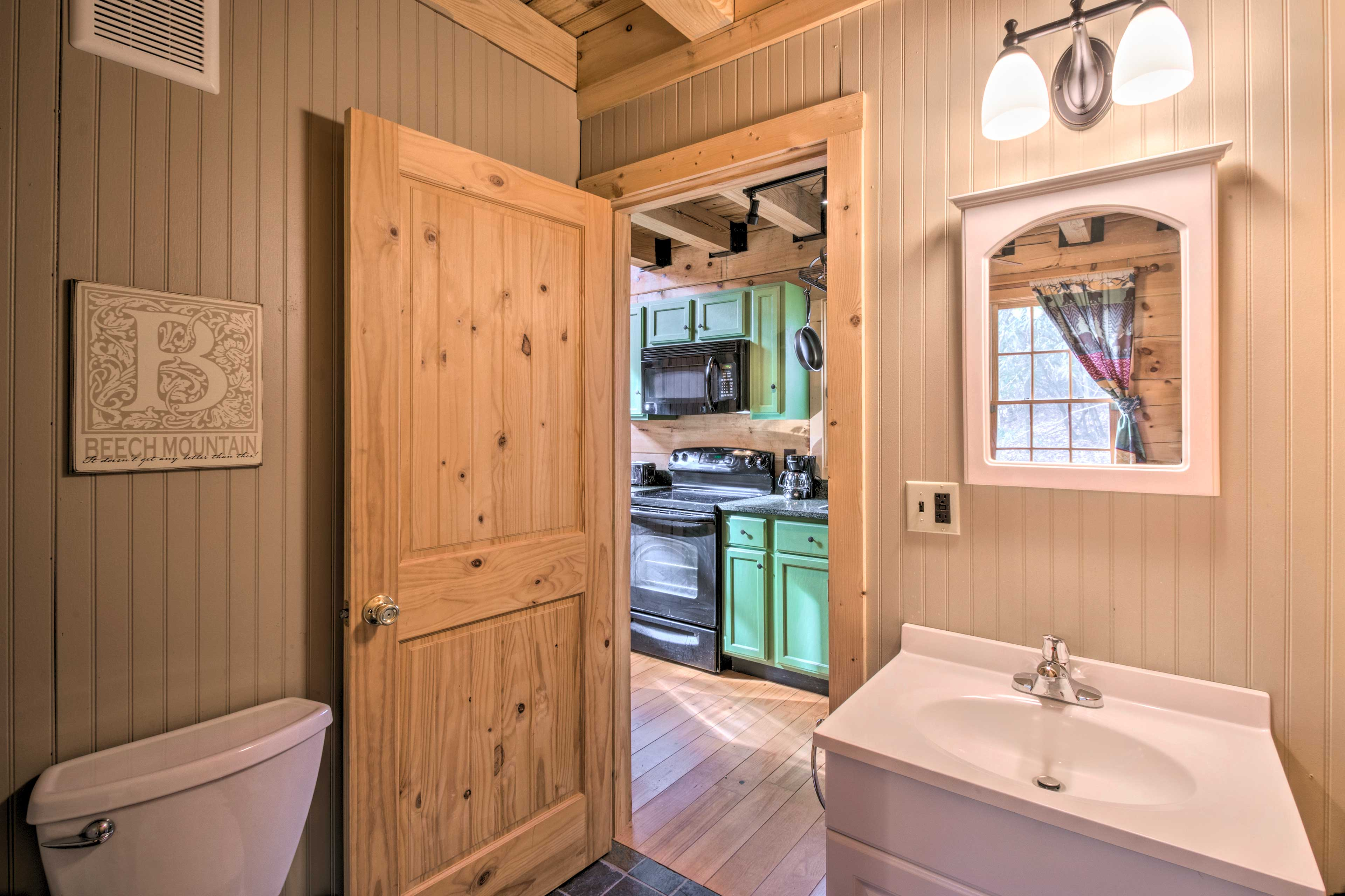 This full bathroom sits just off of the living space.