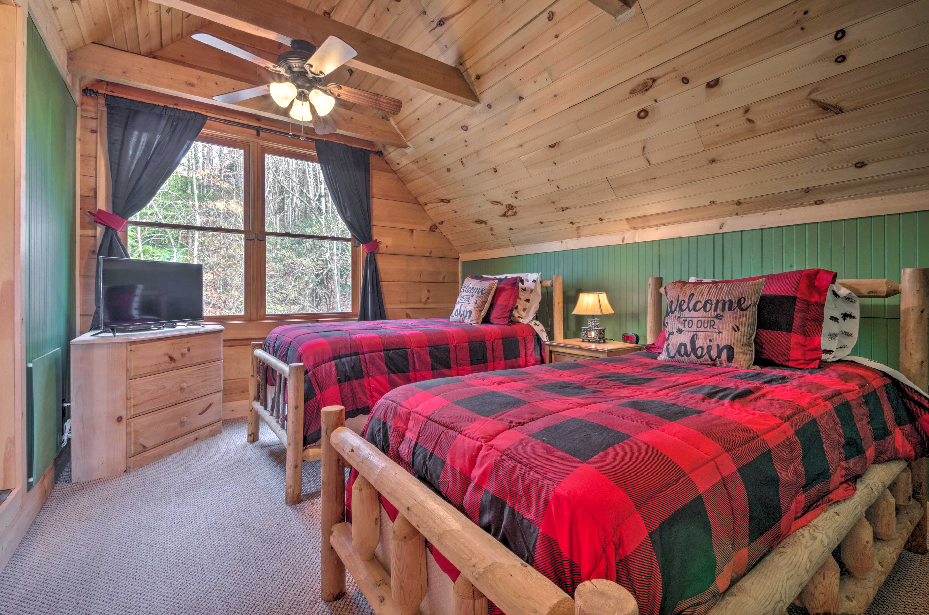 Upstairs, the second bedroom features 2 twin beds.