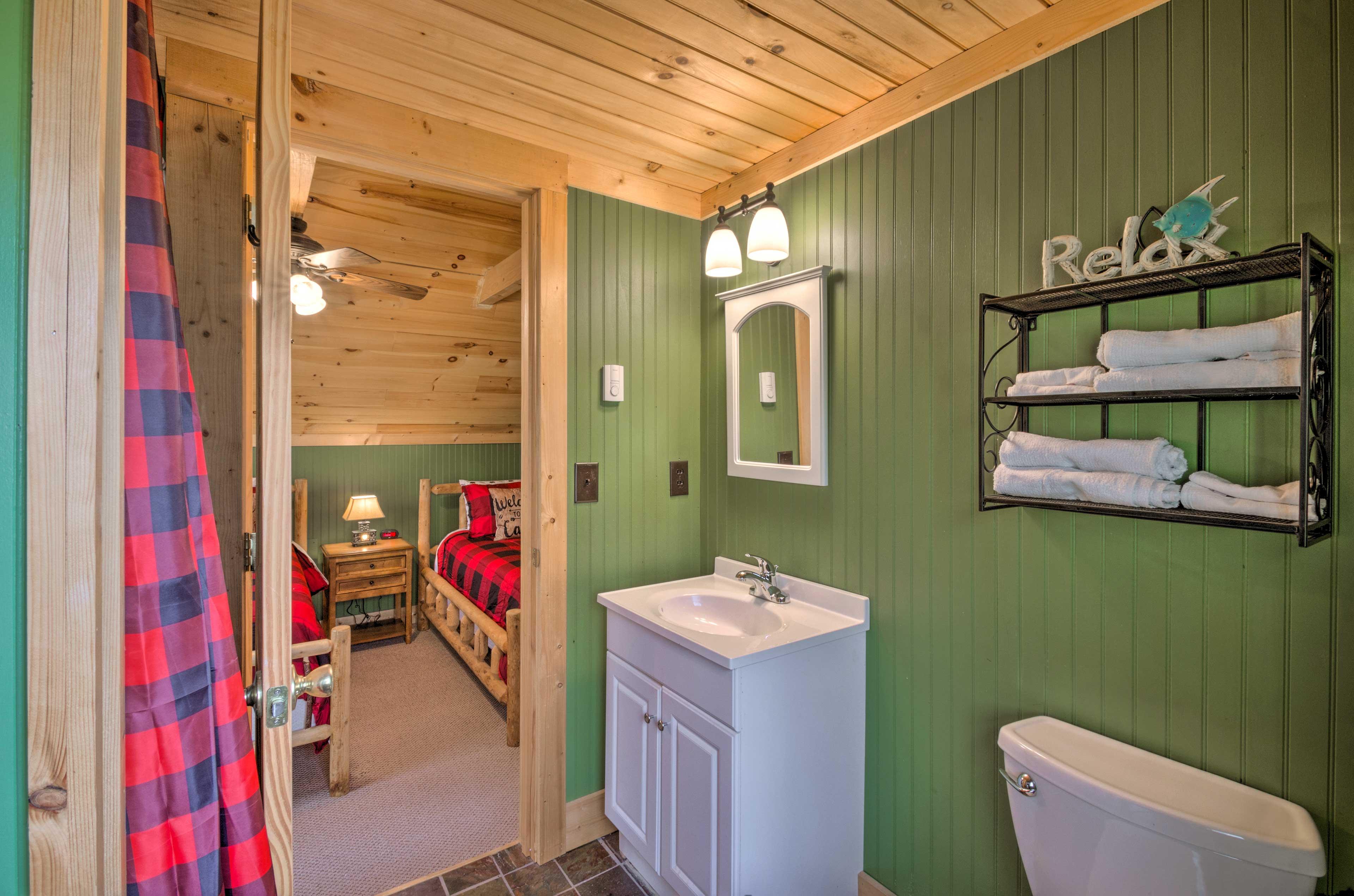 The en-suite bathroom features a shower.