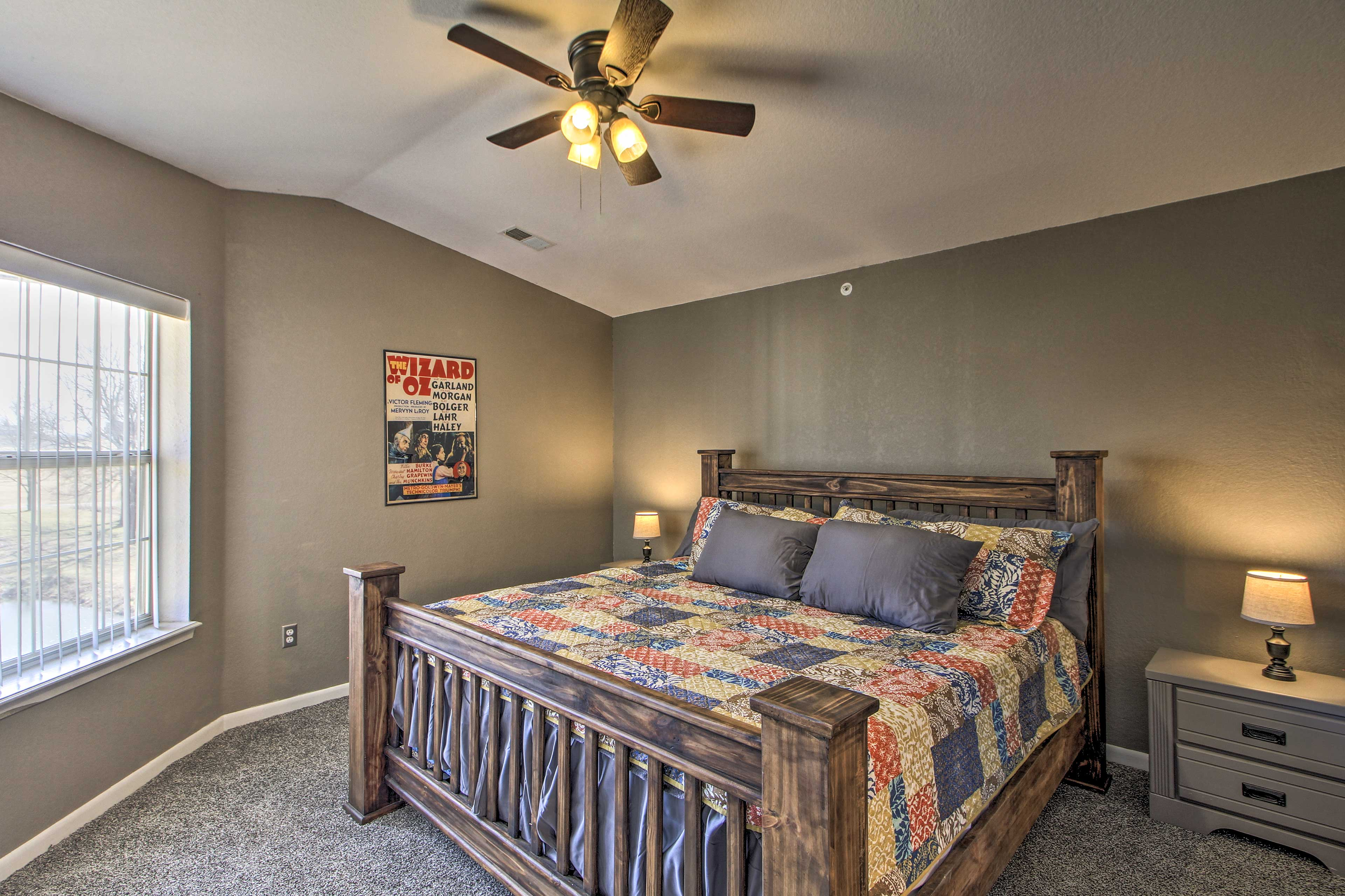 This master bedroom hosts a king-sized bed.