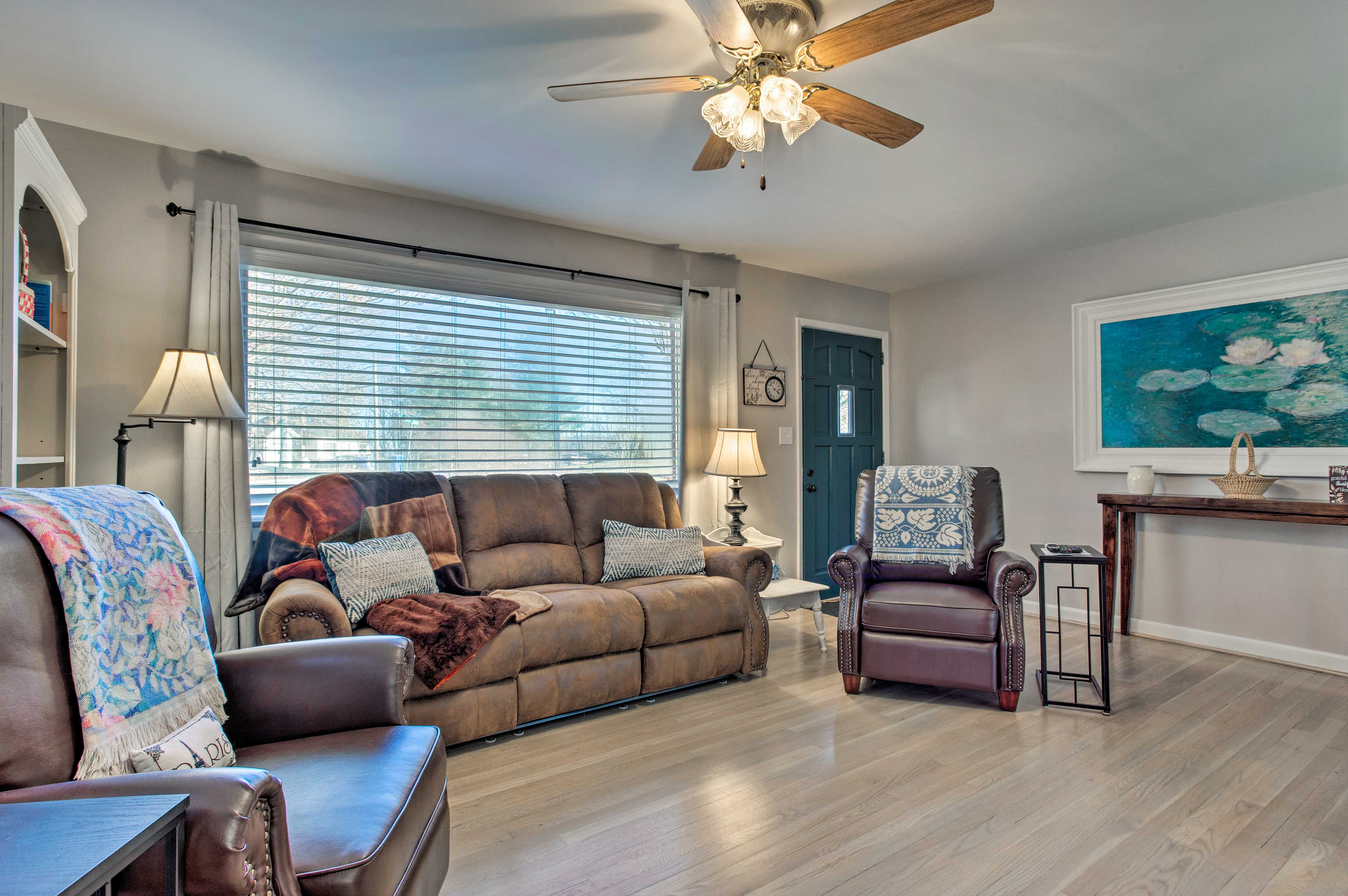 Sprawl out on the soft sofa or claim one of 2 recliners.