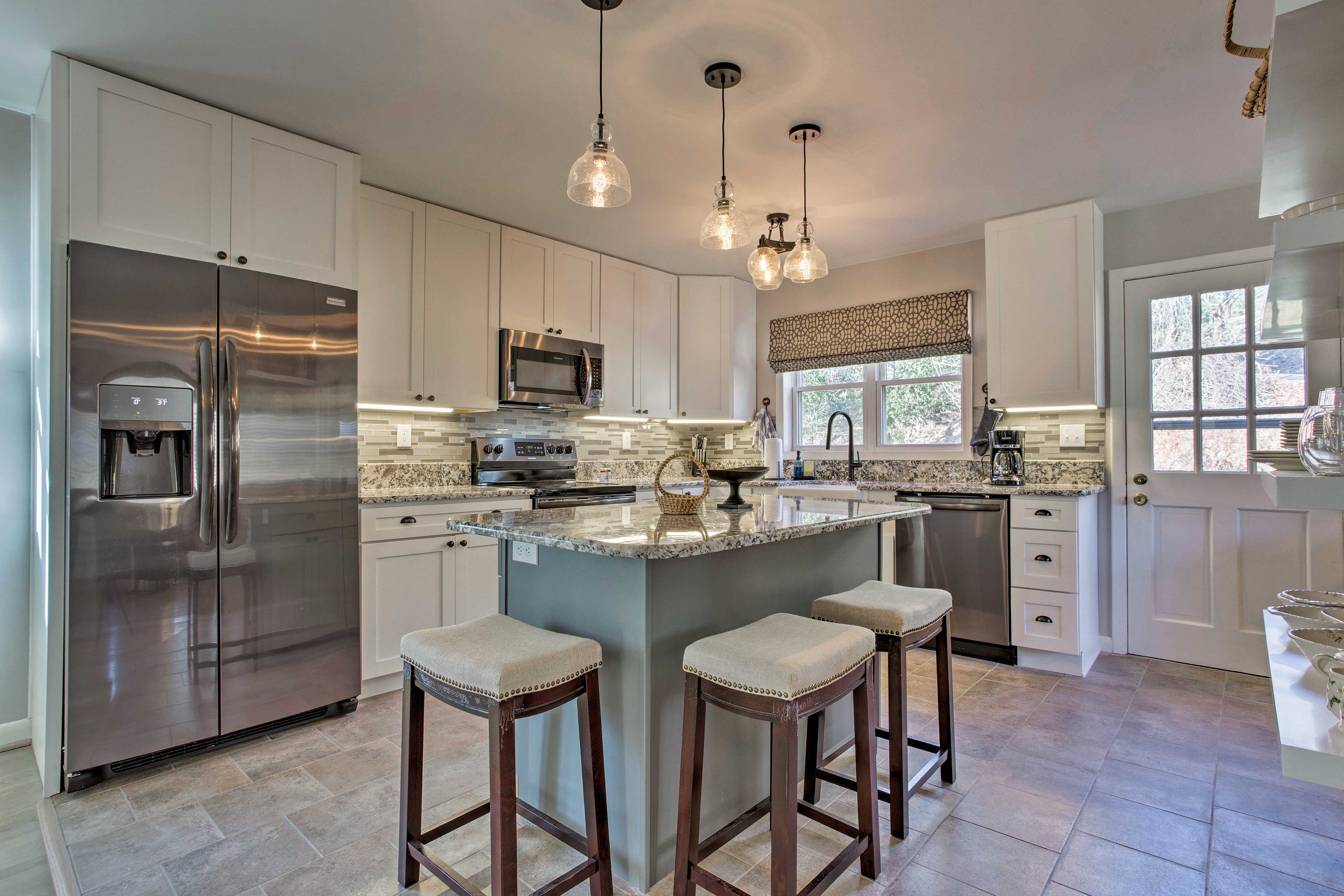 The space boasts stainless steel appliances and granite countertops.