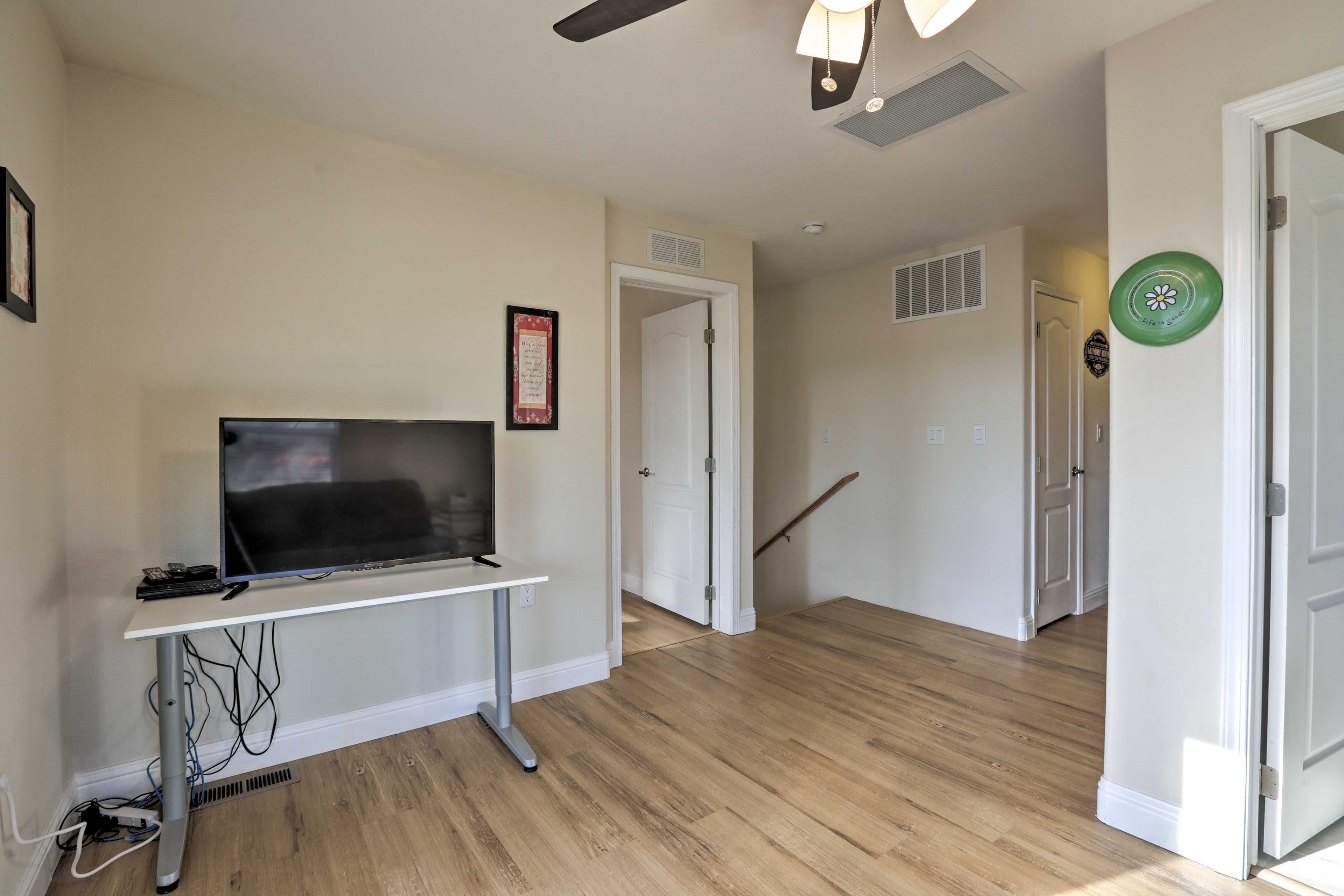 Upstairs, a seating area offers a flat-screen TV and futon.