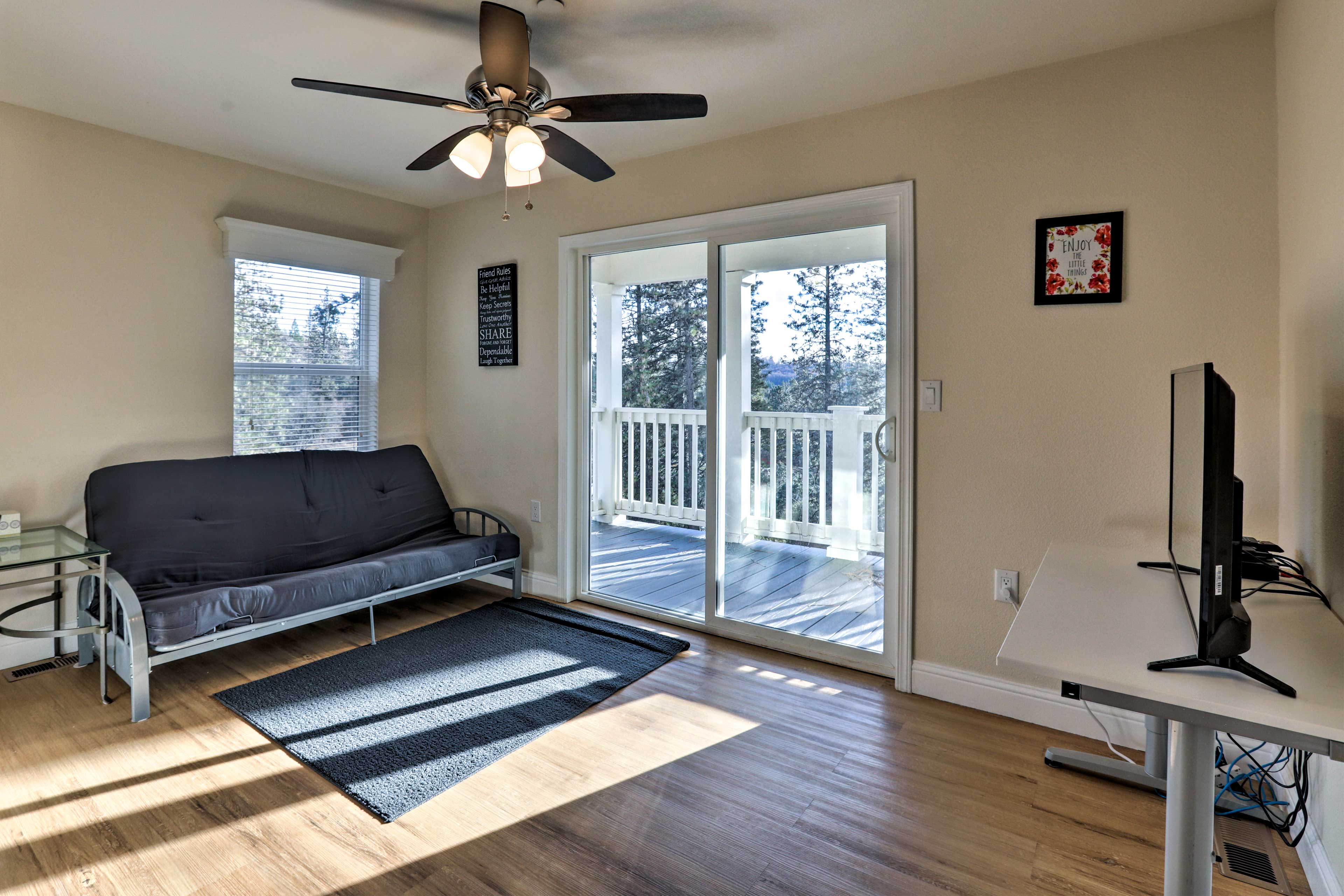 Open the sliding doors and step out onto the balcony.