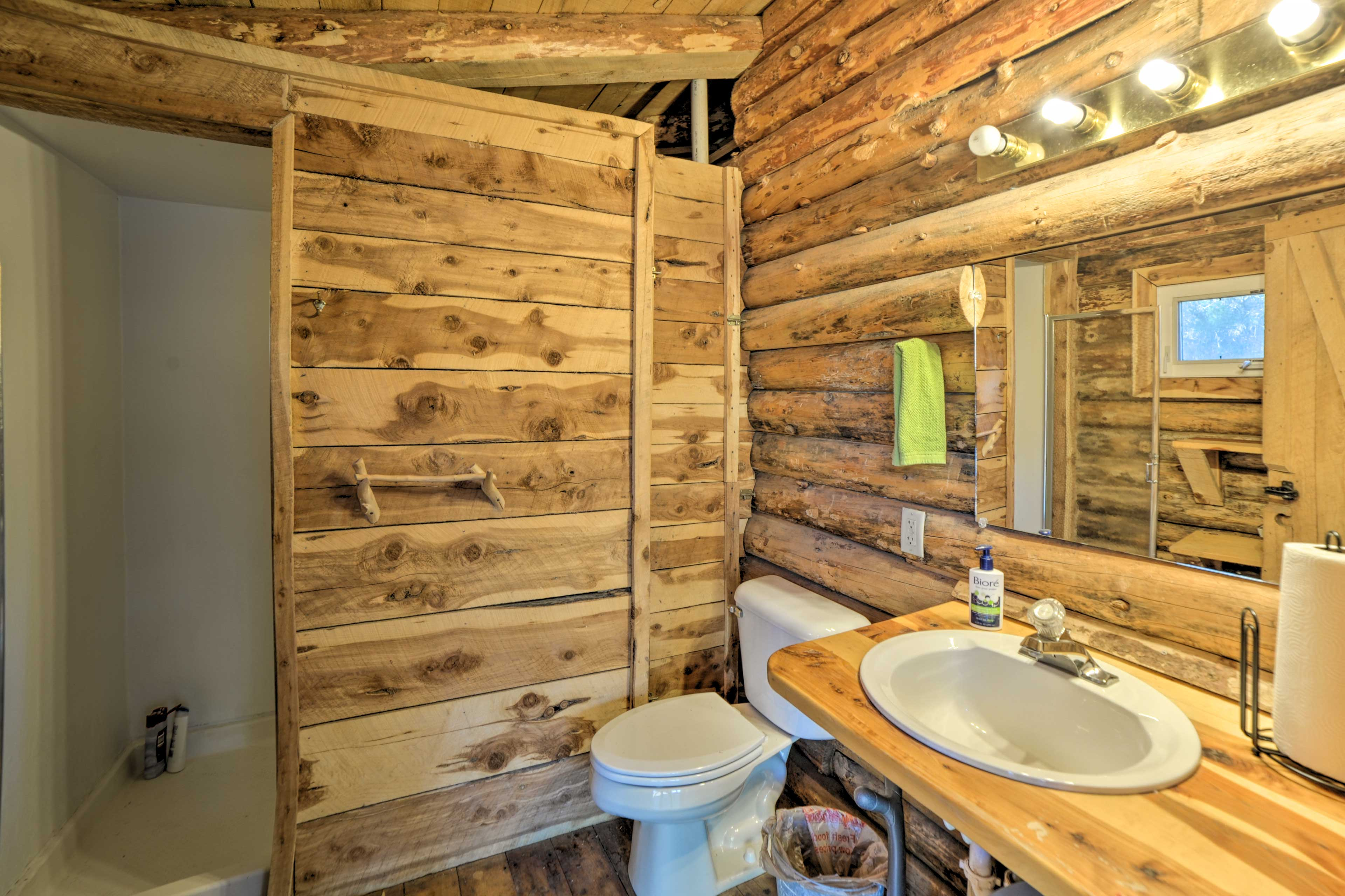 The bathroom is a full with a stand-up shower.